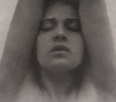 Tina_Modotti_with_her_arms_raised_-_Edward_Weston_restoration.jpg