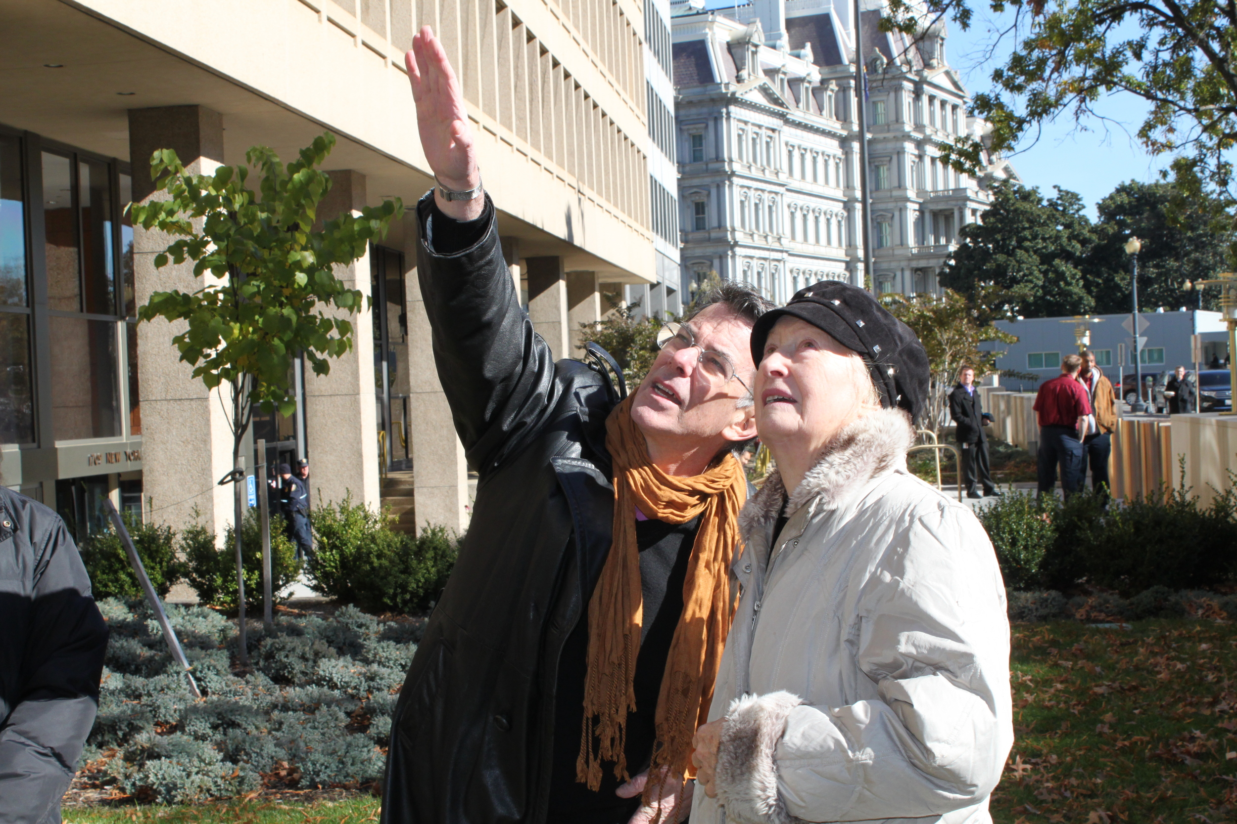 International Arts & Artists President David Furchgott and Artist Emilie Brzezinski observe Arch in Flight's placement in front of the Federal Reserve Building.