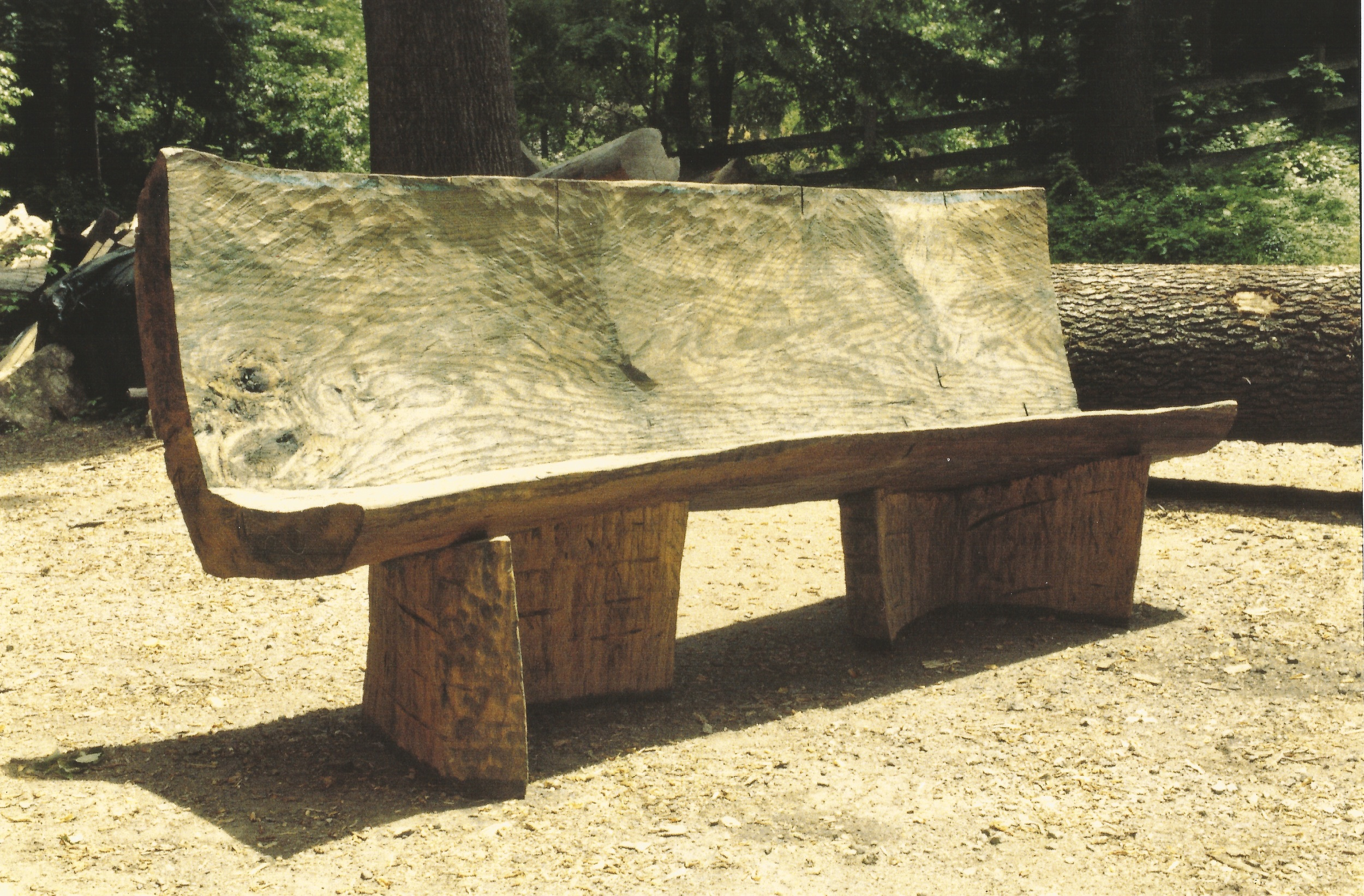 "Bench in Flight II,  1995, red oak, 4'  x 6'10"" x 3'11"". Shown at the Kouros Outdoor Gallery in Kent, Connecticut in November 1995."