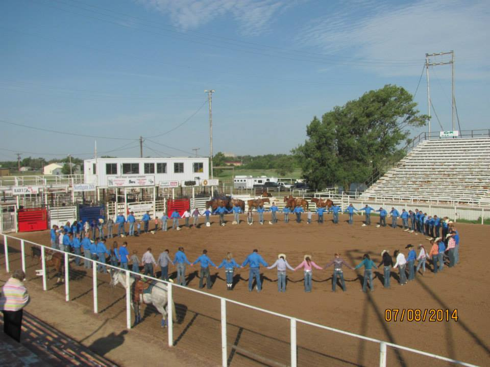 "Here's a great picture of the ""Prayer Circle"" right before the rodeo performance on the last day of the Texas Rodeo Bible Camp."