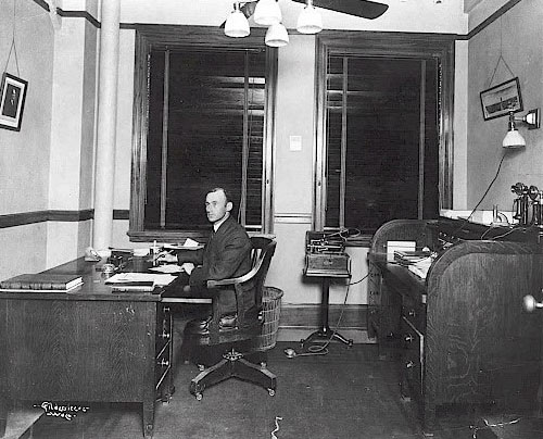 A.R. Wilson at his desk in the ALICO building .  Image Source.