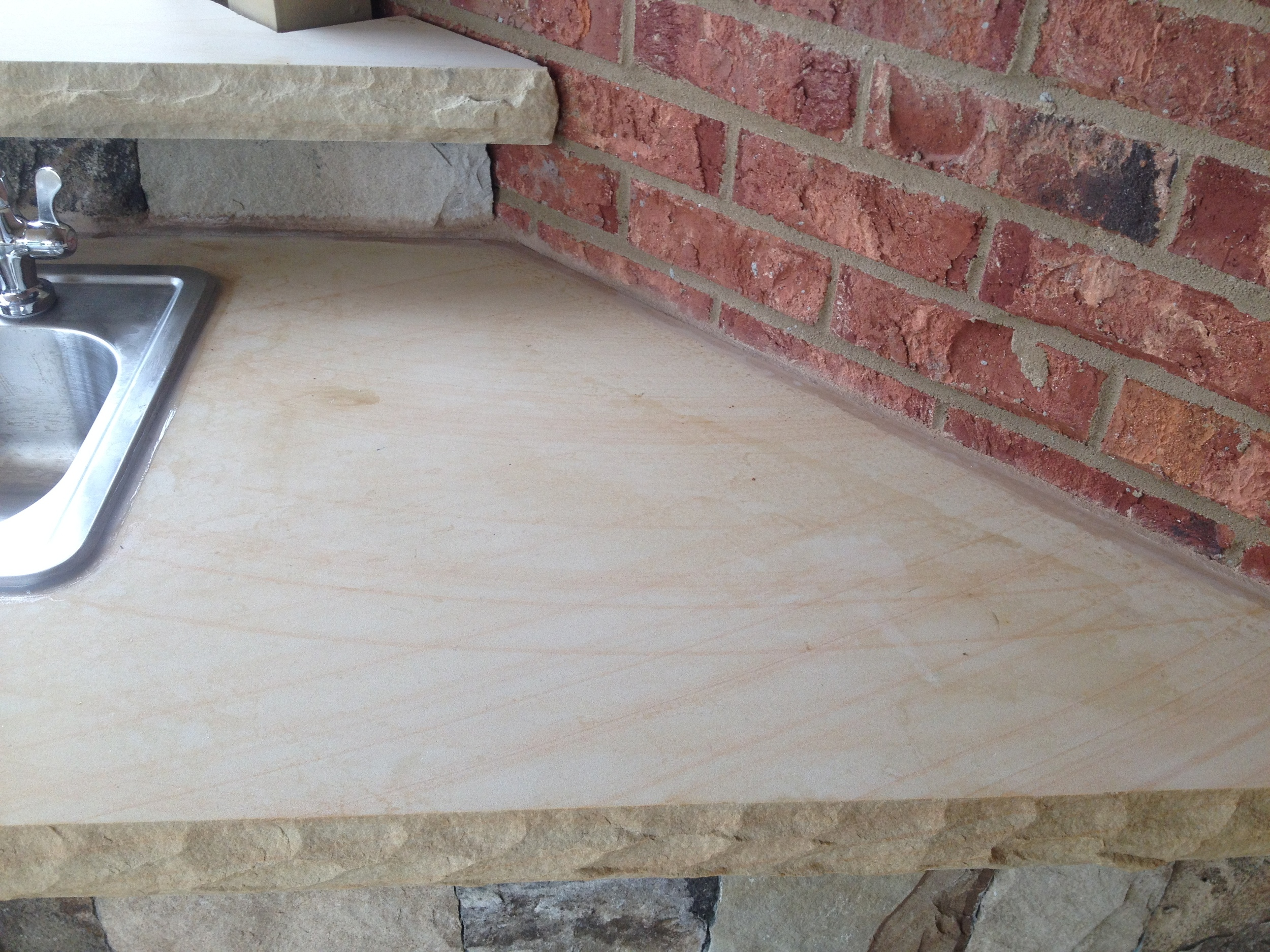 Hand-Grinded and Sealed Sandstone Counter-Top