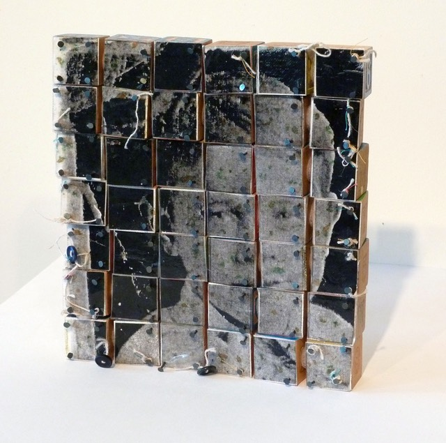 "Gail Skudera,  Block Portrait , 2010, Mixed media on blocks, 9.5"" x 8.5"" x 1.5"", $1,200."