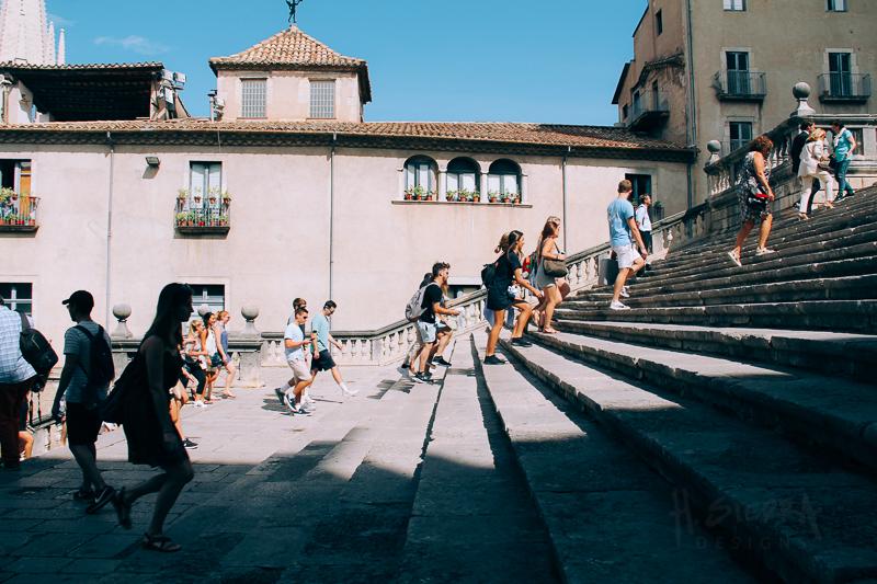 People walking up steps