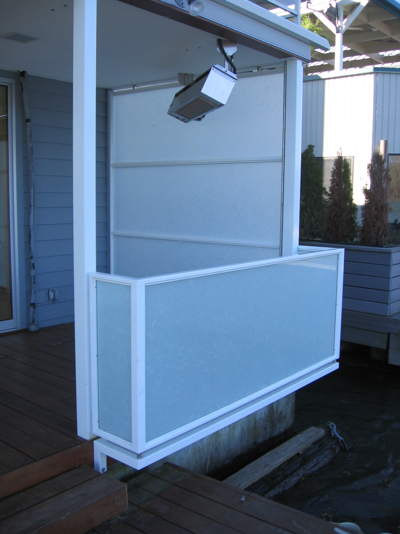 Painted steel guard rail and screen on this houseboat.  Designed by Greenline Fine Woodworking