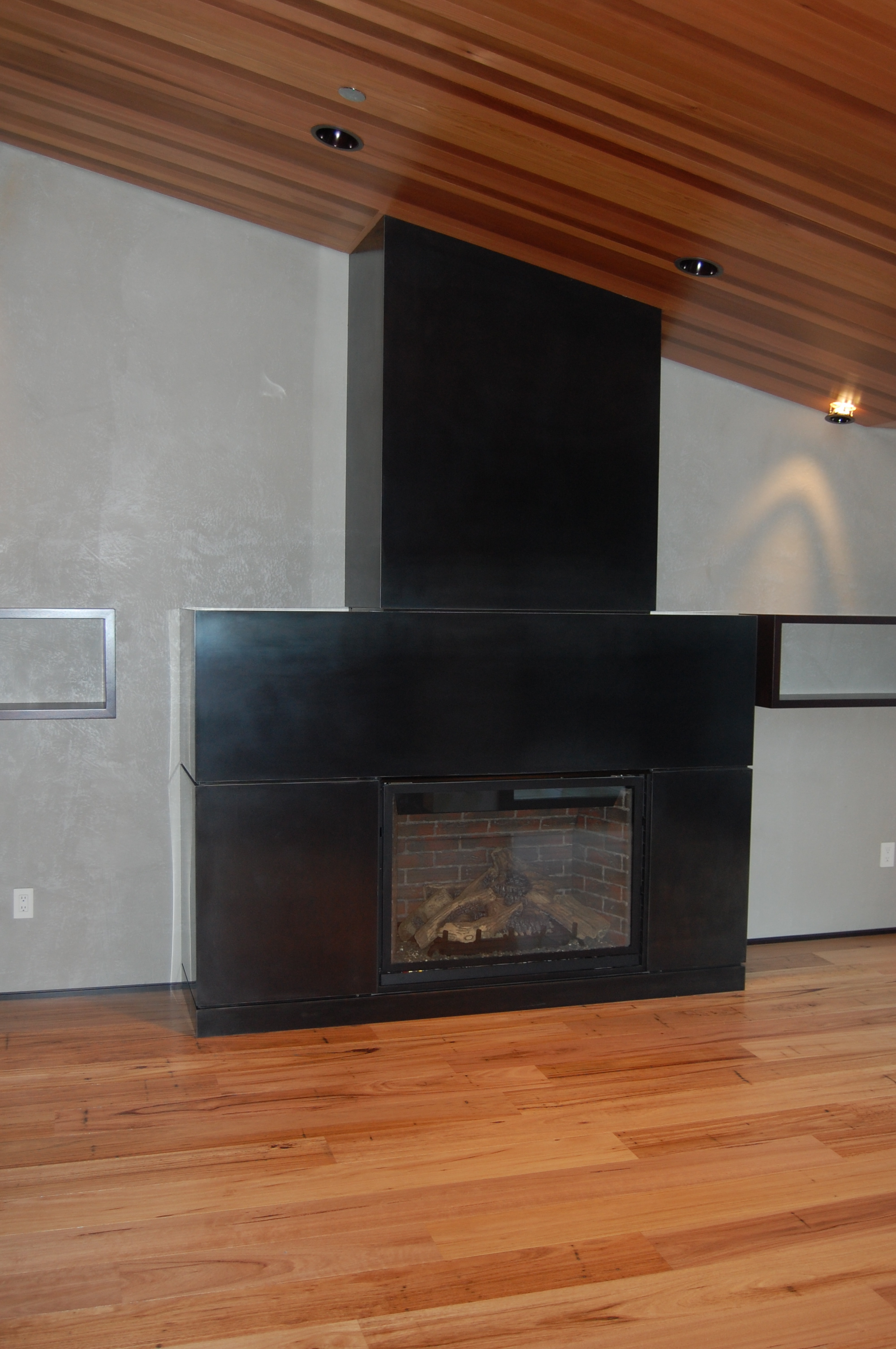 Fireplace Surround out of hot rolled steel.   Designed by Giulietti/Schouten Architects