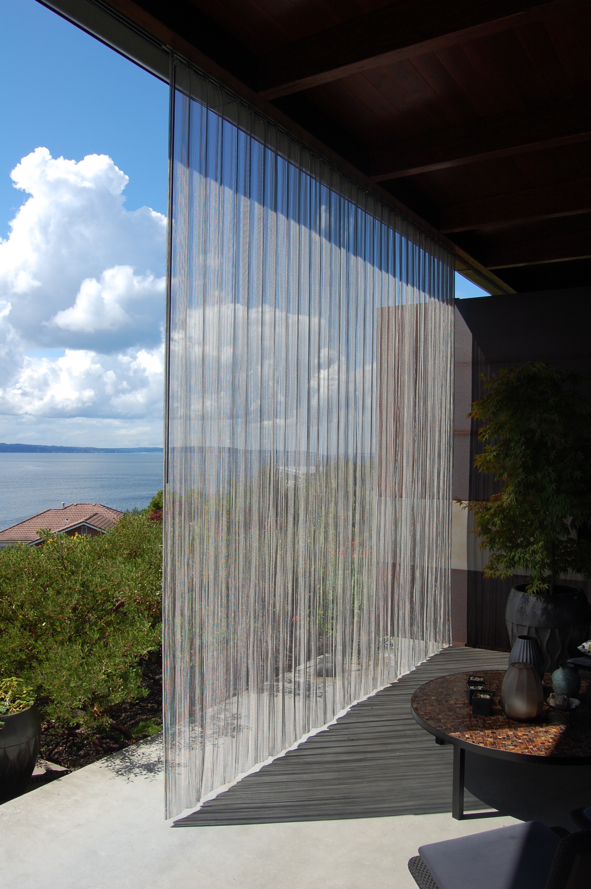 Woven stainless steel screen on a track.  Designed by Eggleston/Farkas Architects