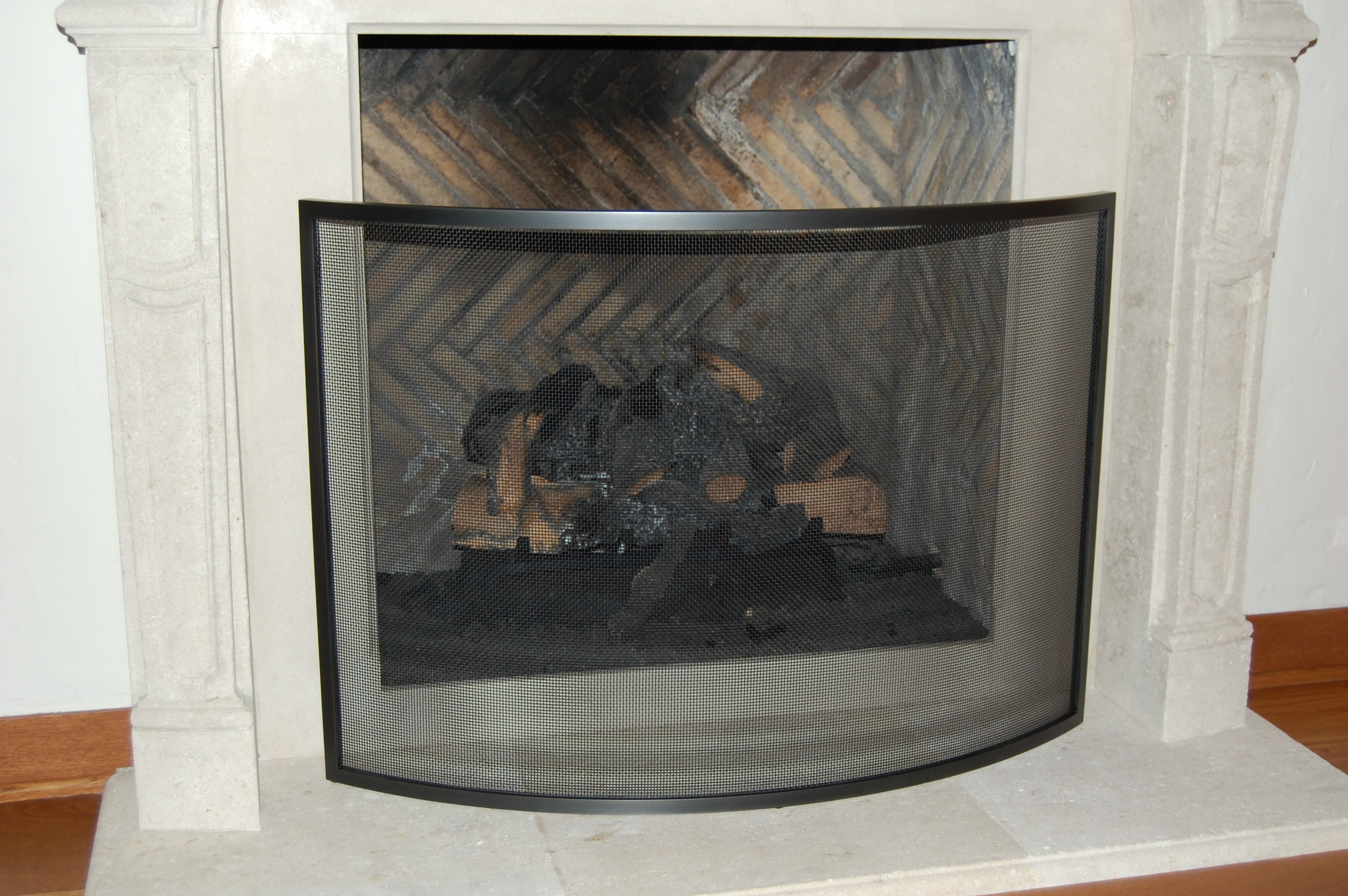 Fire screen built out of blackened steel.  Designed by Formed Objects