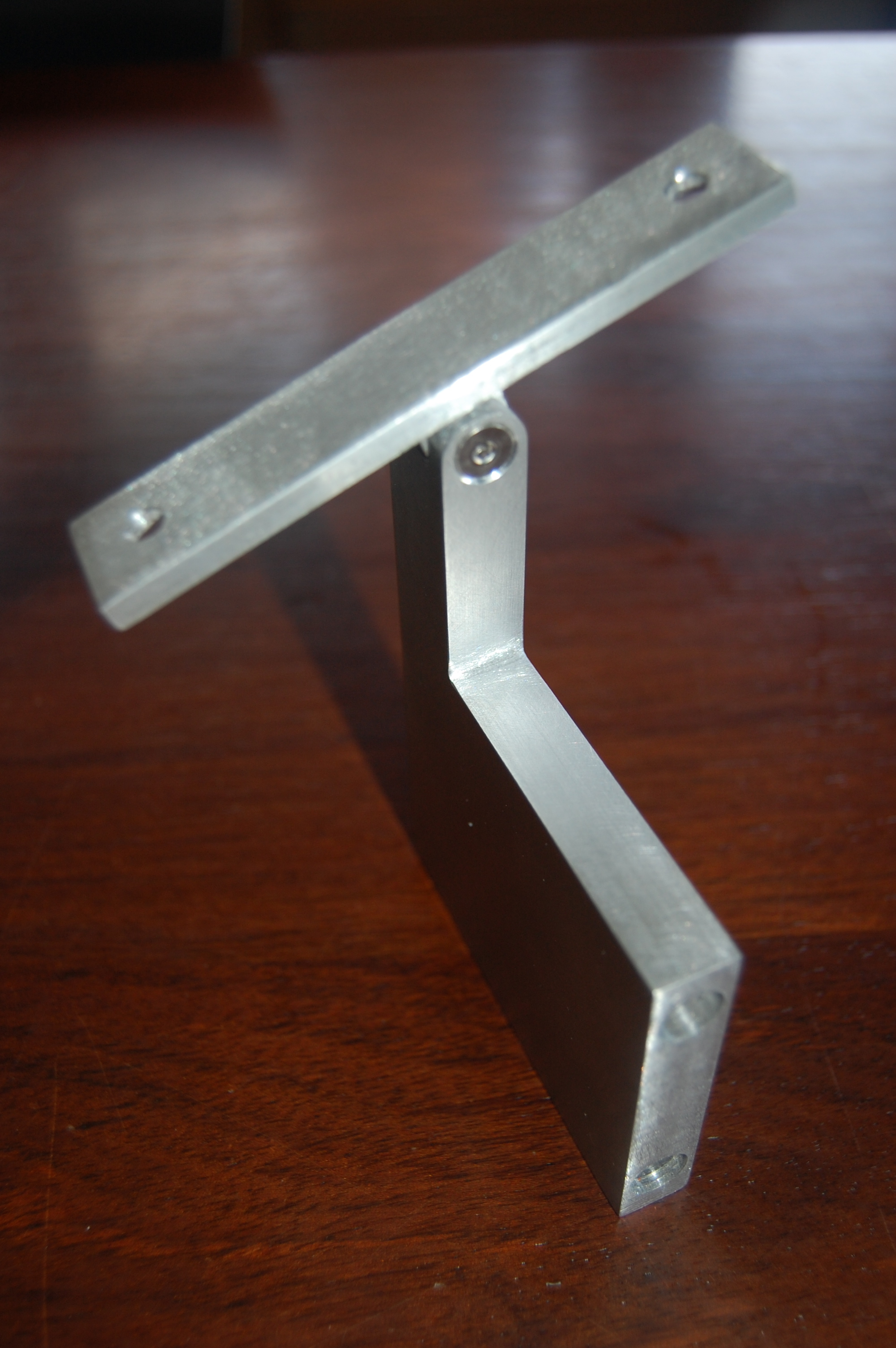 Adjustable pitch grab rail bracket out of aluminum.  Designed by Formed Objects