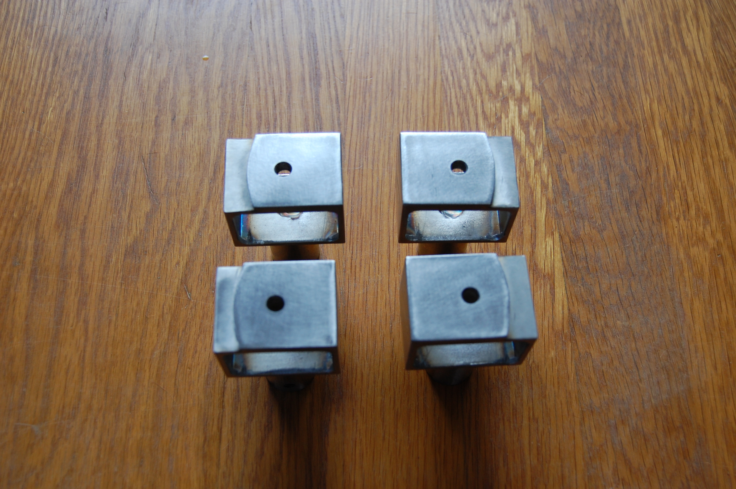 Stainless steel door handle standoffs.  Designed by Group Jake Collaborative