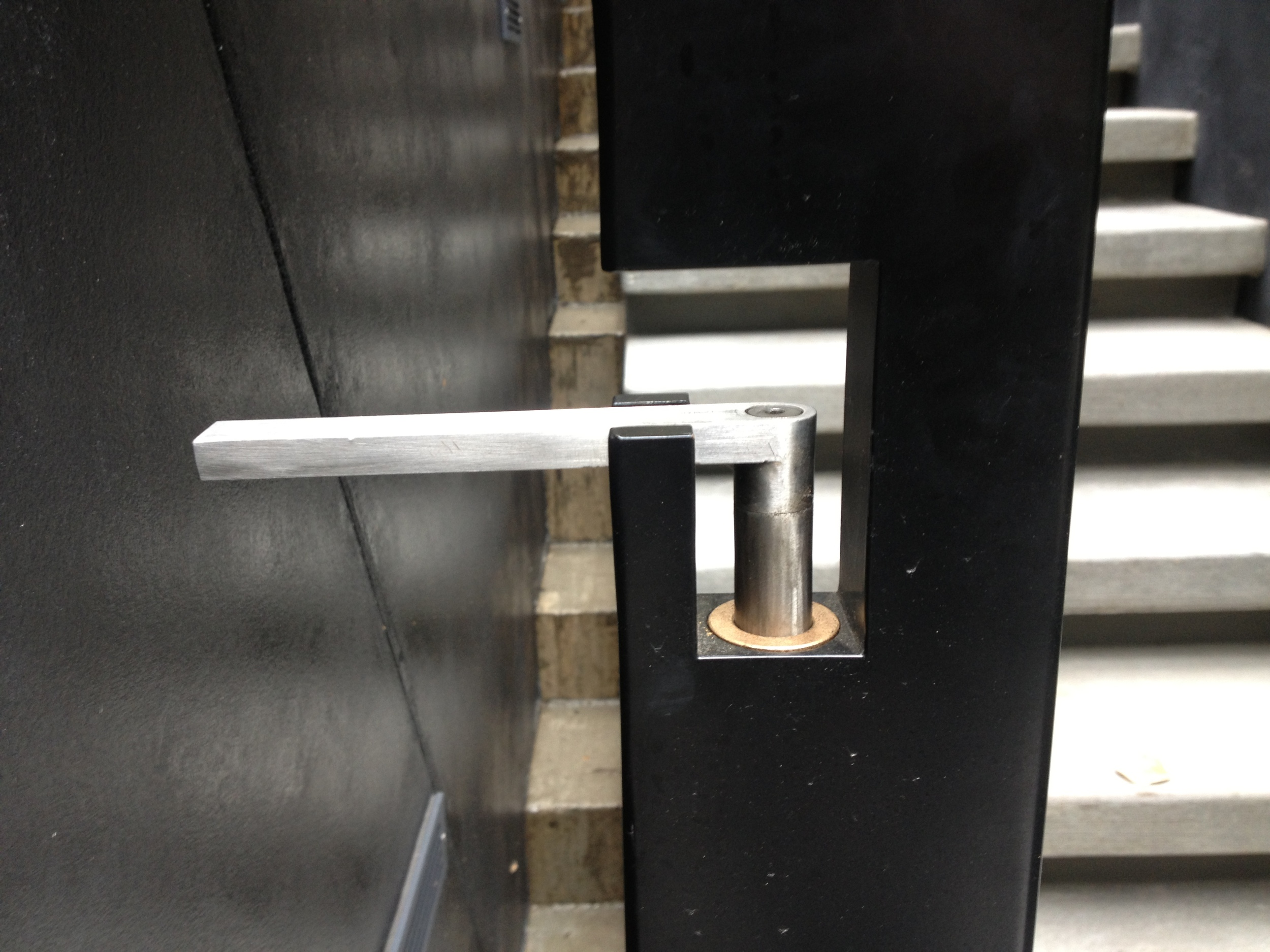 Gate with stainless steel handle that doubles as a cane bolt. Bronze bushing for long term no maintenance movement.  Designed by Skylab Architecture/Formed Objects