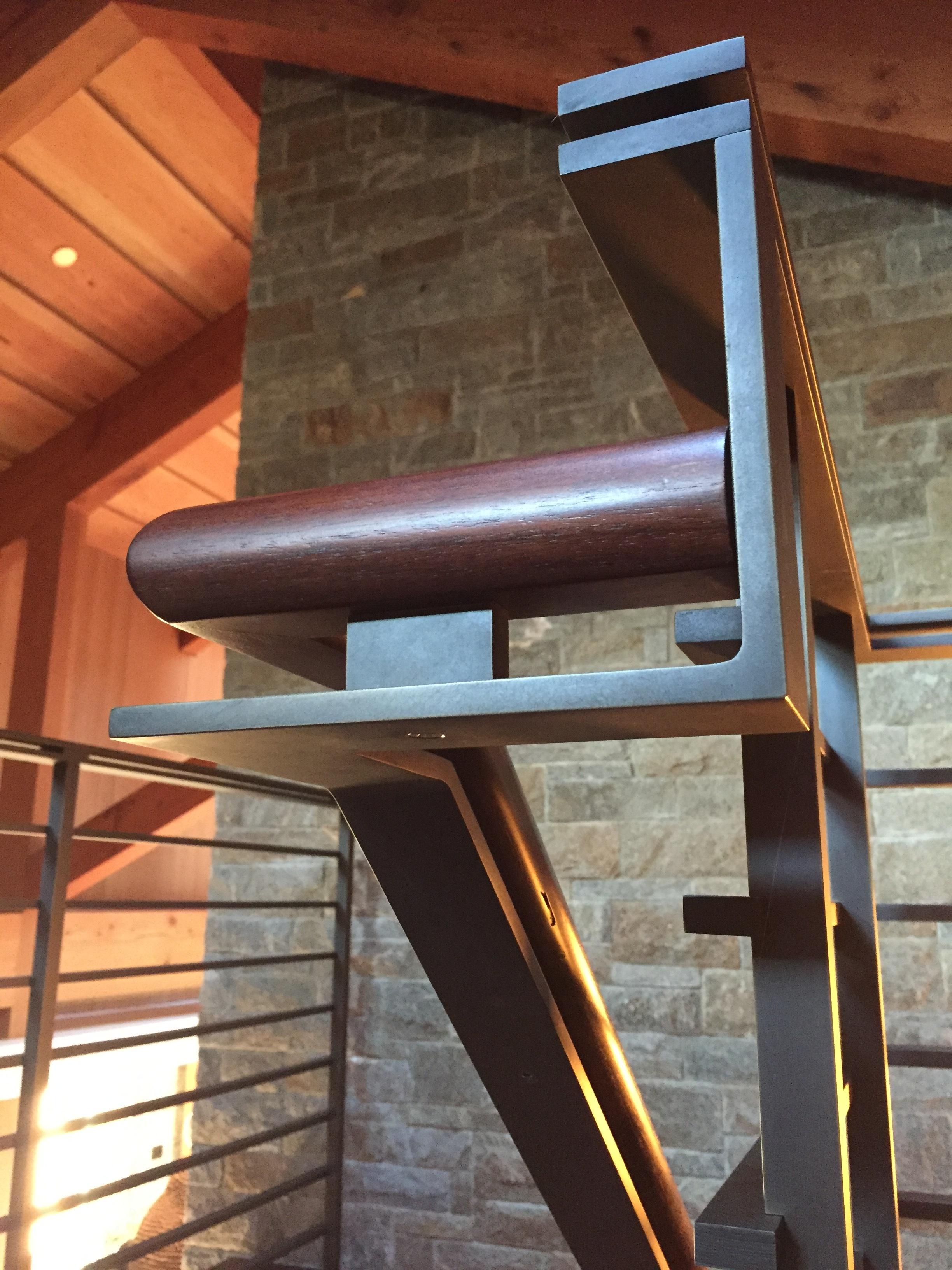Brass railing with dark patina.  Designed by Richard Brown, Architect