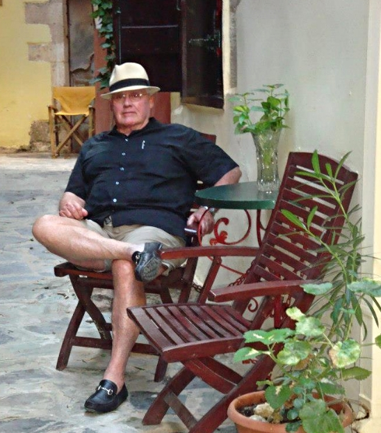 A man of leisure relaxes in Hania, on the Island of Crete, Greece. Come sit a spell. Let's swap a story or two.