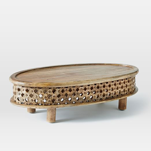 Carved eclipse coffee table