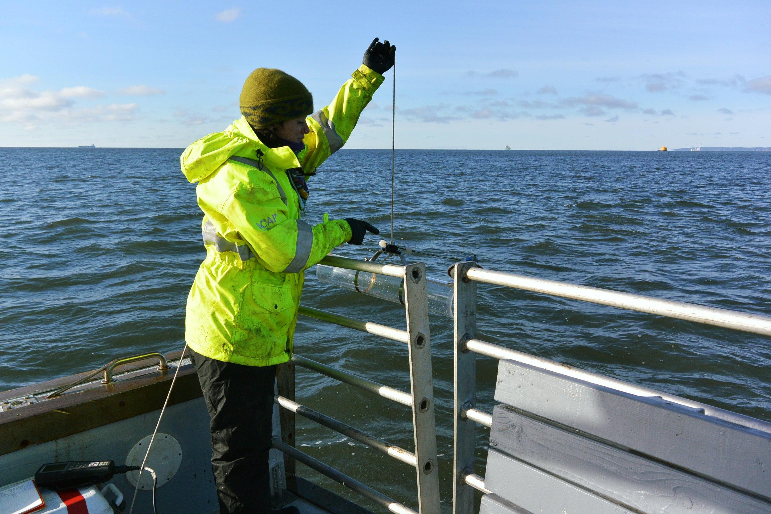 Lowering the Van Dorn water sampler into the water