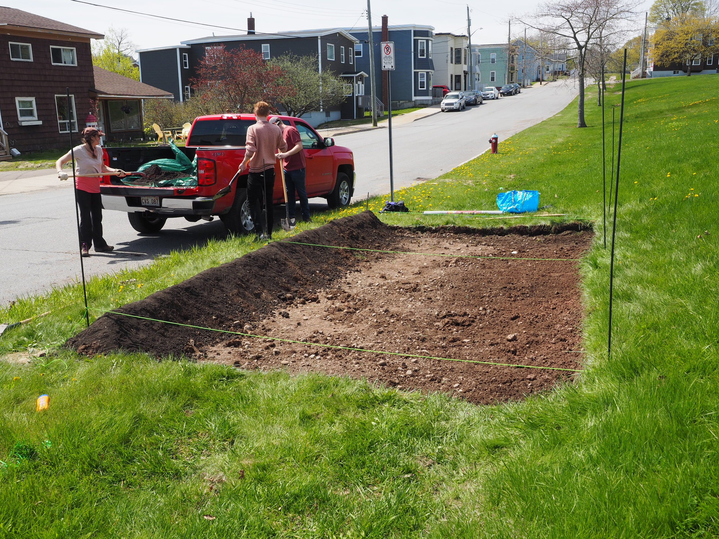 ACAP Staff installing a berm on the lower side of the garden.