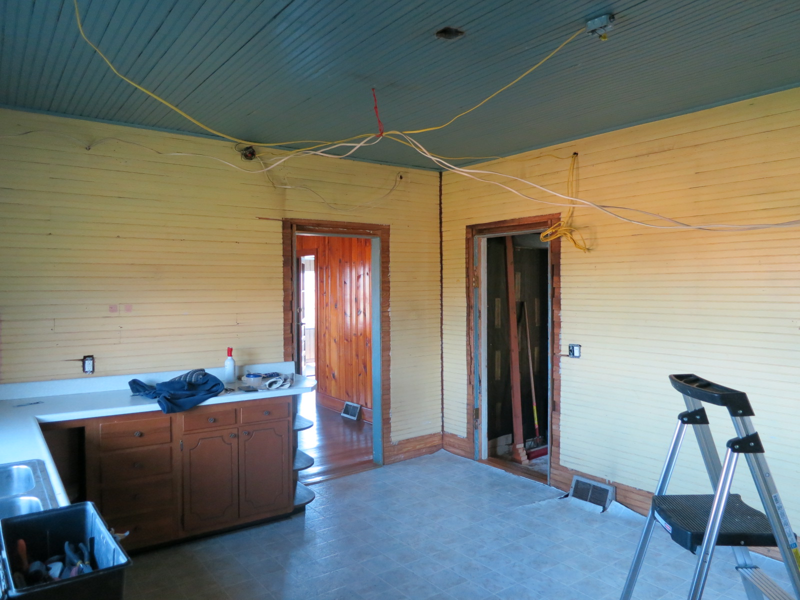 kitchen: uncovering old beadboard ceiling & walls