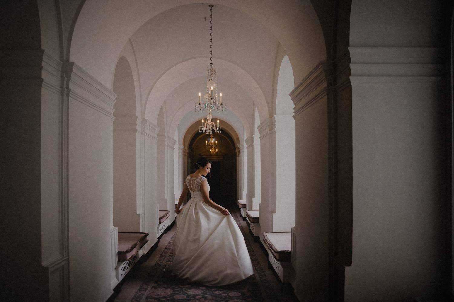 Antonia stepping into the light, fluffing the dress as she gets acquainted with her attire for the day. - The Ned, London.
