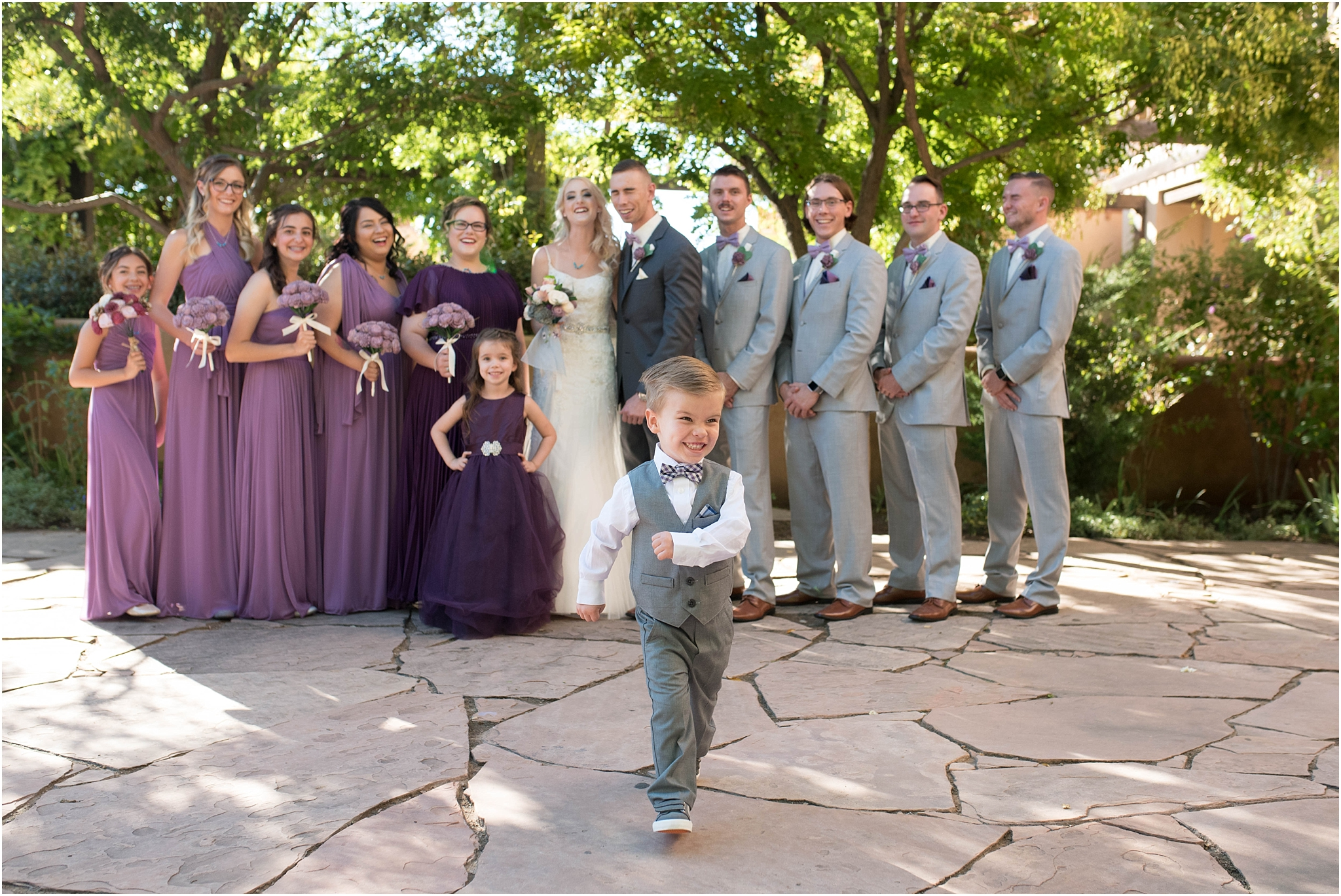 hotel-albuquerque-wedding-photographer-ceremony-wedding-party-purple-grey-suits-bridesmaids-courtyard-chaco-venue