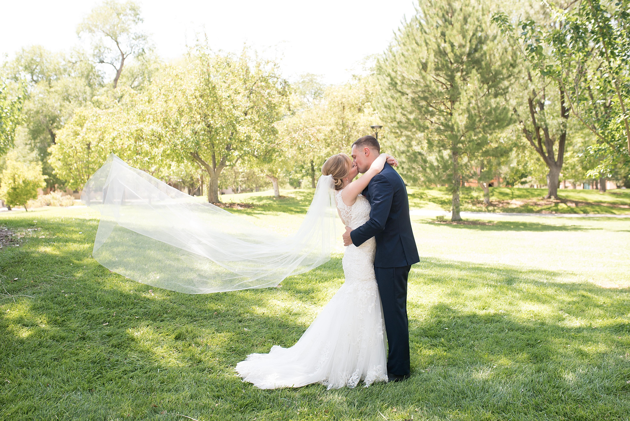 Wedding dress from Ann Matthews, jewelry by helzberg diamonds, suits by suits unlimited, hotel parque central wedding photographed by albuquerque wedding photographer kayla kitts photography