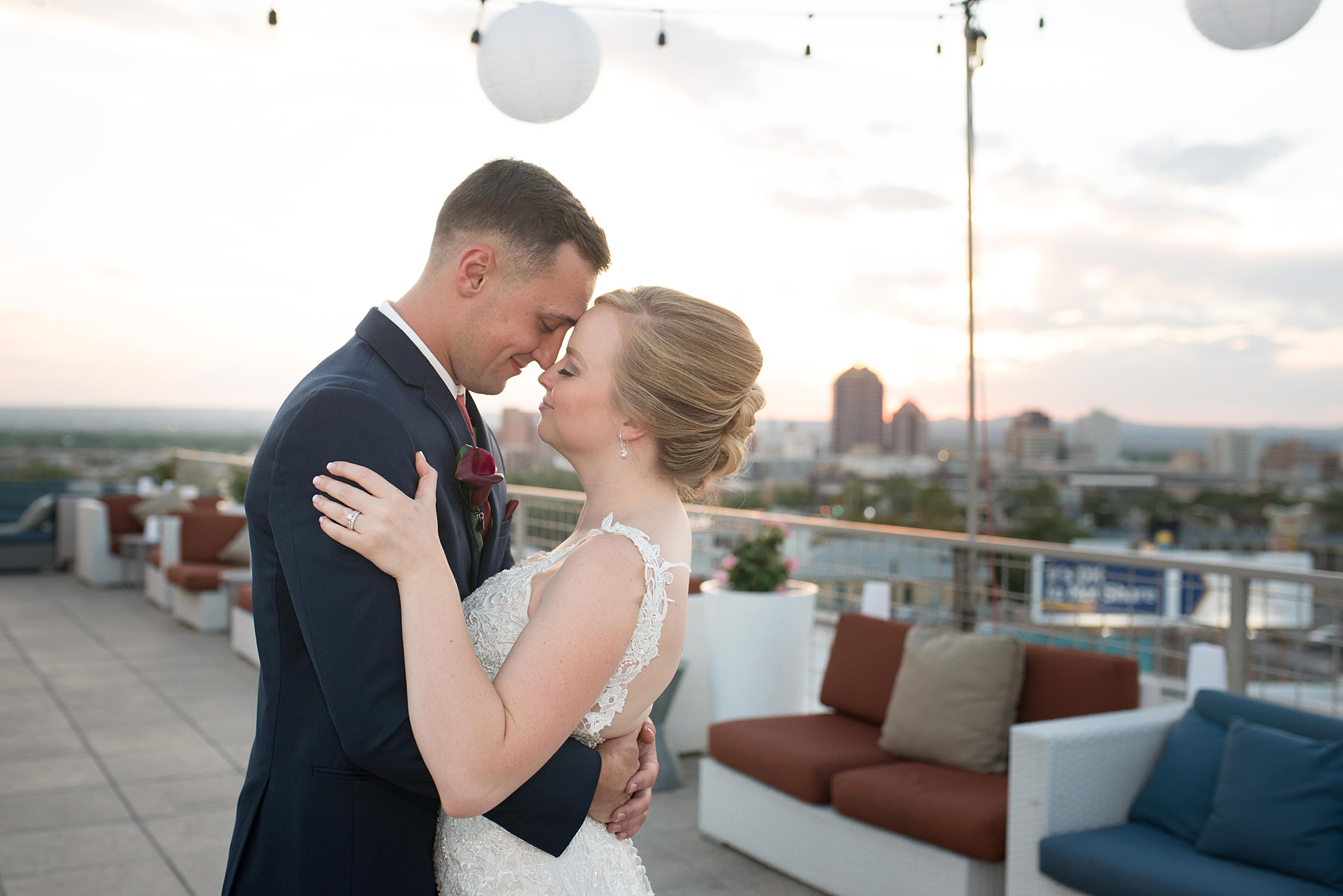 Wedding dress Ann Matthews, jewelry by helzberg diamonds, suits by suits unlimited, hotel parque central wedding photographed by albuquerque wedding photographer kayla kitts rooftop wedding