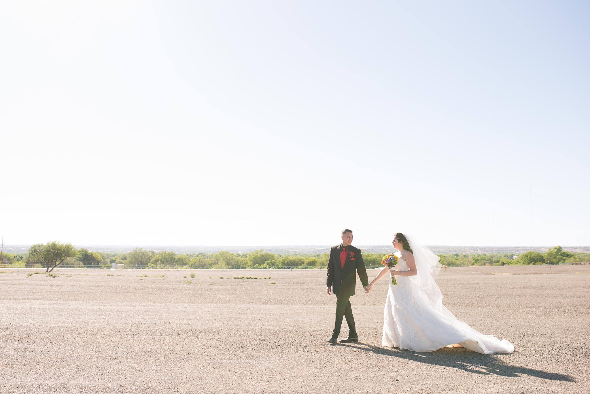 Balloon fiesta wedding with large wedding party in albuquerque new mexico.  Dress by Bridal Elegance by Darlene and jewelry by enchanted jewelers.  Albuquerque Wedding Photographer.