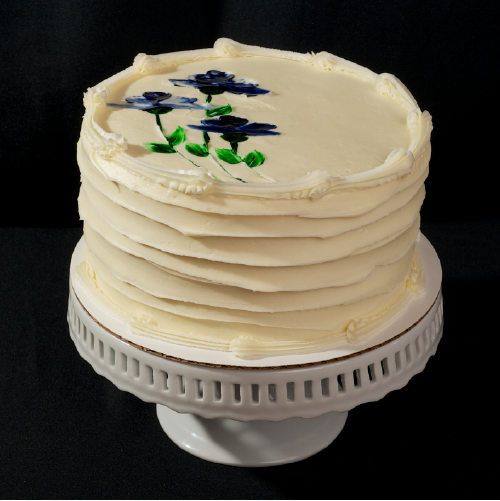 "Almond Poppy Seed  Two layers of almond poppy seed cake topped and filled with cream cheese icing.  6"" (serves 8): $28  