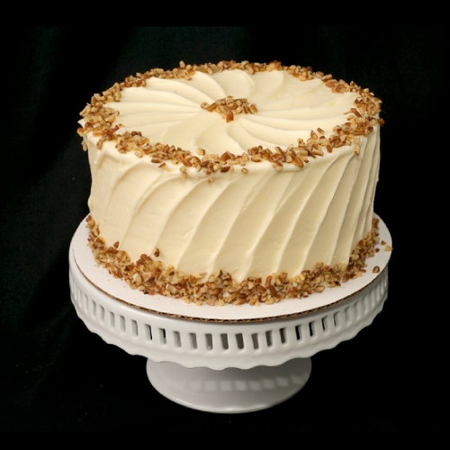 "Pumpkin  Two layer pumpkin spice cake with cream cheese frosting.  6"" (serves 8): $28  