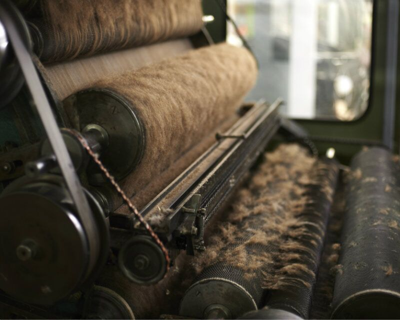 Fibre being carded at the Mill- pin for later