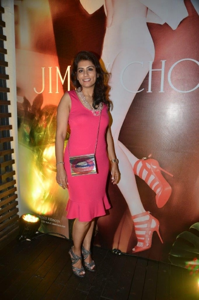 Deepika Gehani wearing an Emporio Armani dress and carrying the Jimmy Choo Lip Candy along with the Jimmy Choo Collar shoes