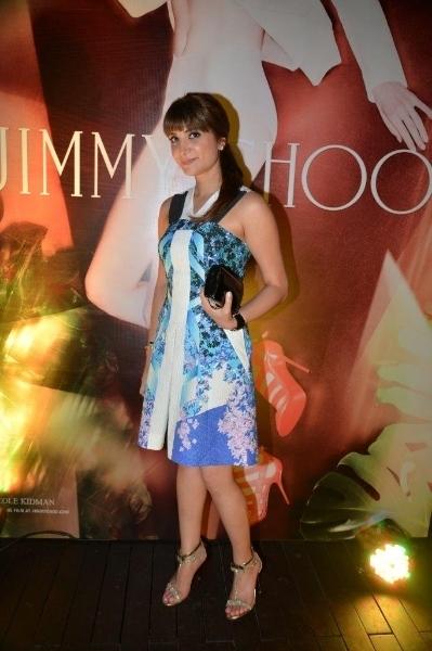 Host Michelle Poonawalla wearing Jimmy Choo Escape & carrying Jimmy Choo Carmen