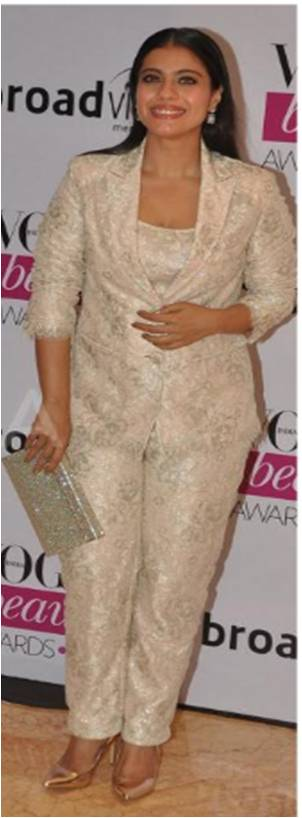 Kajol in a Shehlaa by Shehla Khan pant suit complimented by a Jimmy Choo Clutch at the Vogue Beauty Awards 2014
