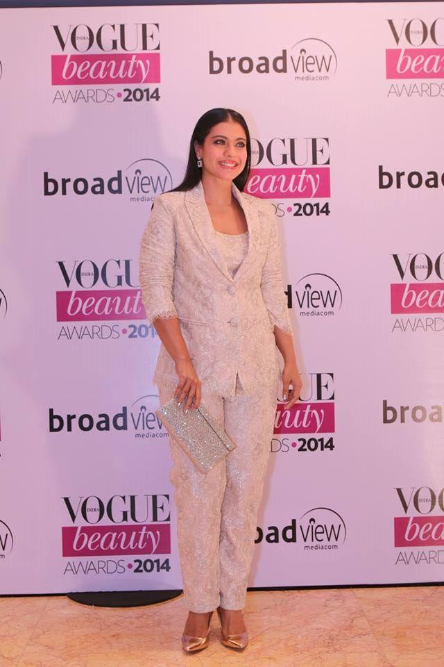 Kajol in Shehlaa by Shehla Khan carrying a Jimmy Choo clutchat the Vogue Beauty Awards 2014