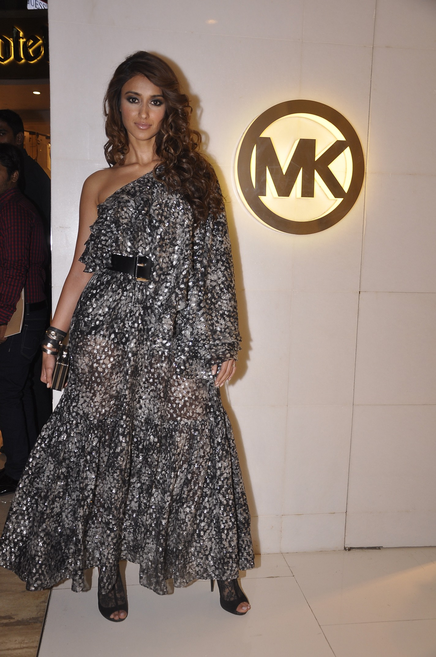 Ileana D'Cruz:    Floral metallic fil coupé Michael Kors dress wing- sleeve top from the Fall 2014 collection and a black MICHAEL Michael Kors Elsie clutch from the Holiday 2015 collection.