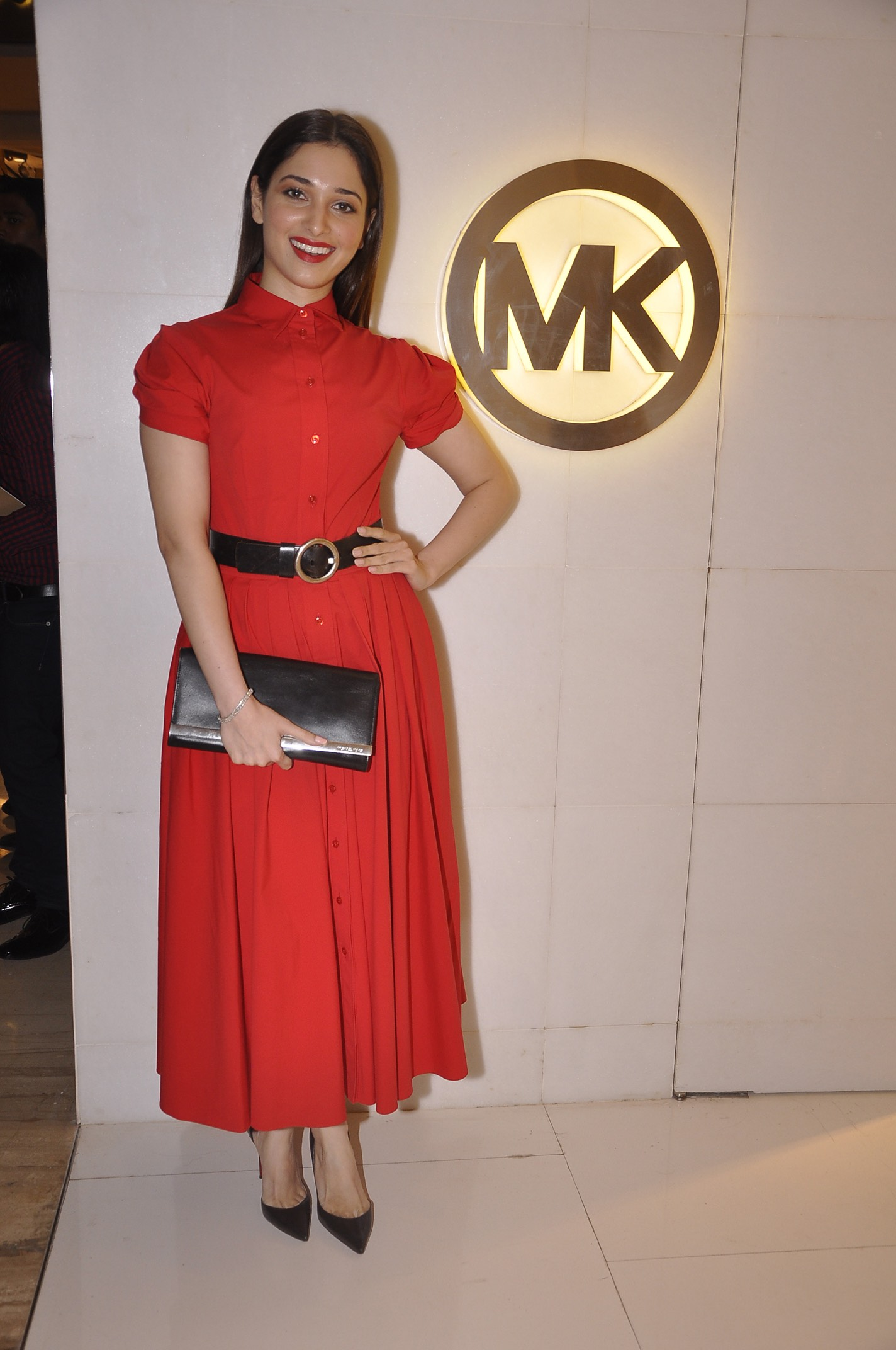 Tamanna Bhatia:    Scarlet   Michael Kors dress and black clutch from the Transeason 2014 collection.