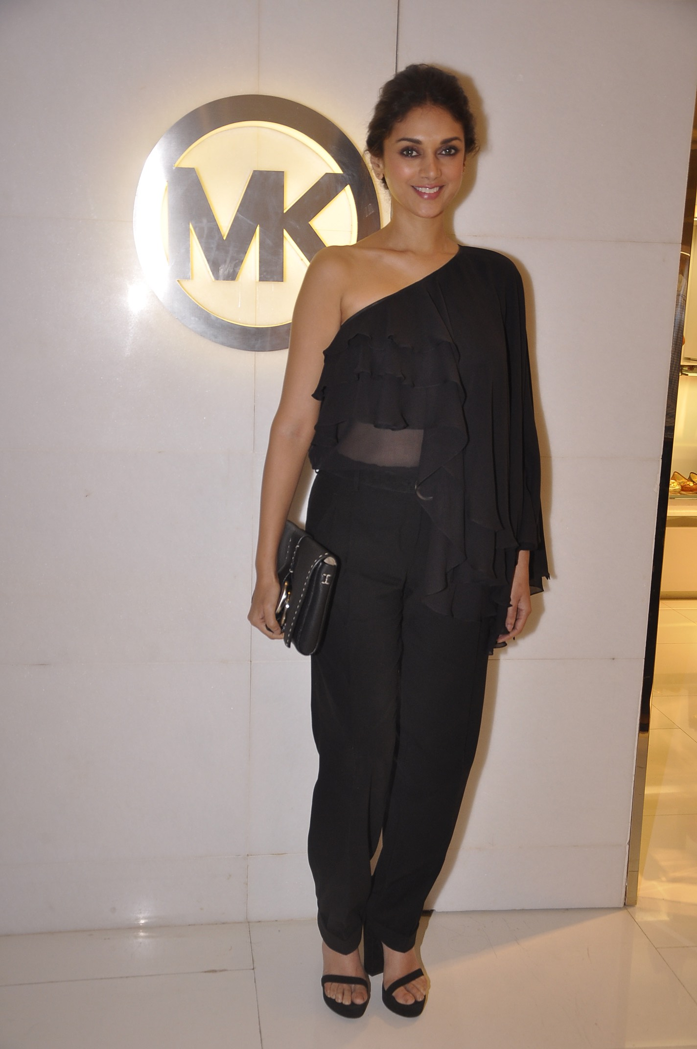 Aditi Rao Hydari   :   Black Michael Kors one-shoulder top, trousers and black Julie clutch, all from the Fall 2014 collection.