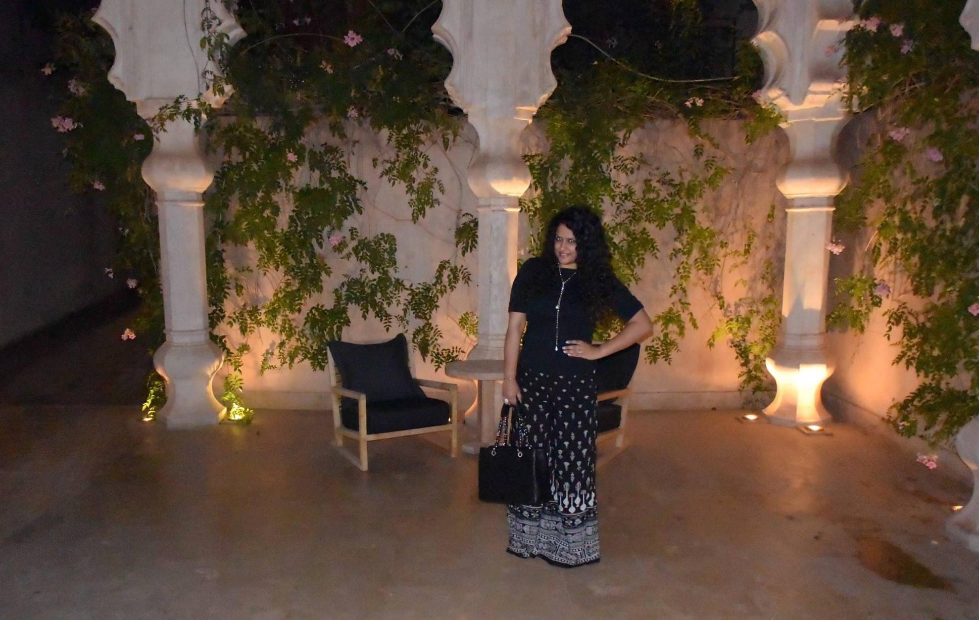 Pants: Tarun Tahiliani, Top: Ralph Lauren, Neckpiece & Ring: Isharya, Bag: Chanel