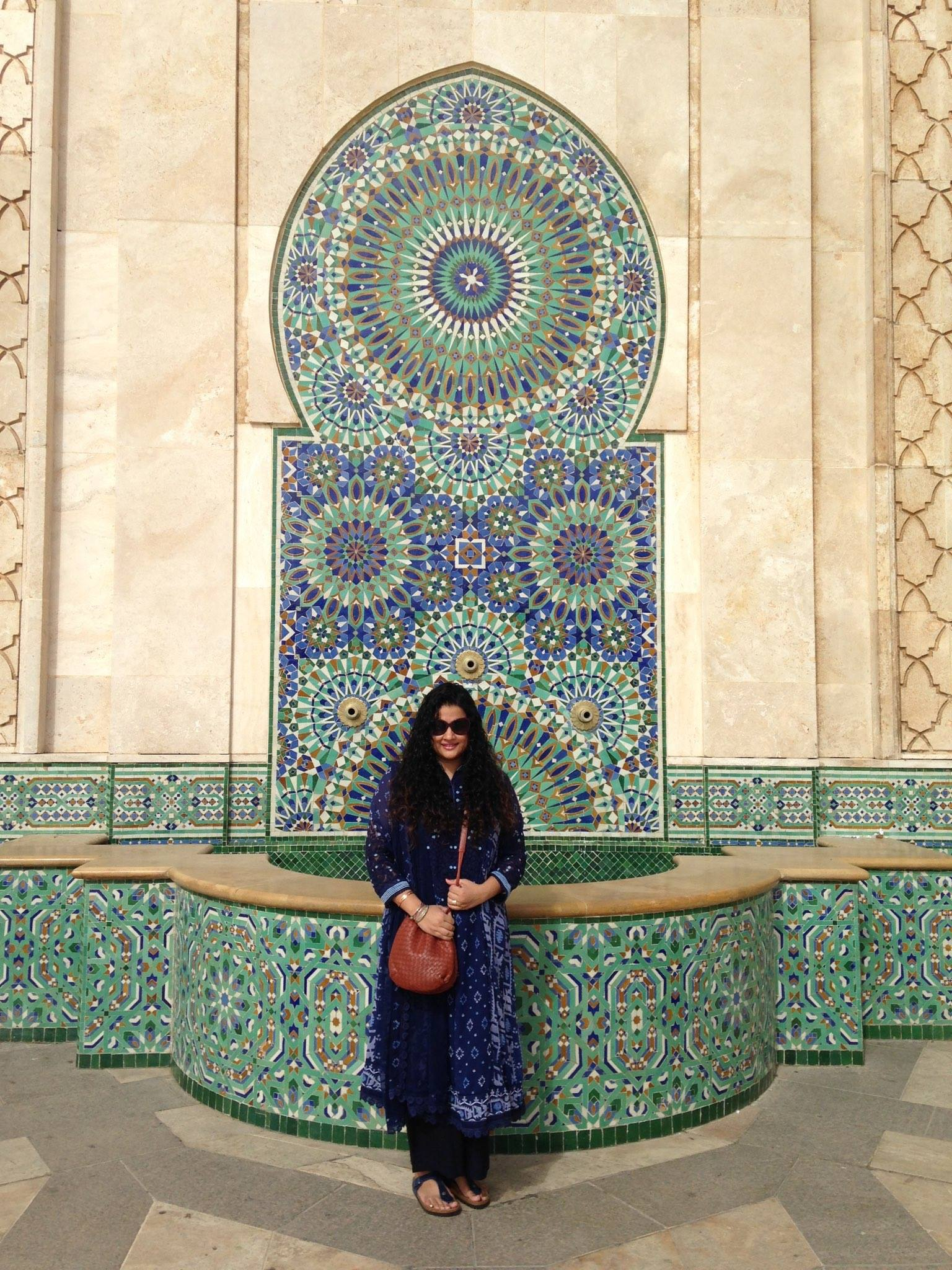 Hassan II Mosque in Casablanca    Kurta, Pants & Stole - all part of a set: Label by Ritu Kumar, Sling: Bottega Veneta, Sunglasses: Dior: Bangles: Hermes, Sandals: Birkenstock, Ring Bulgari