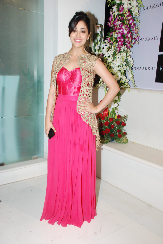 Yami Gautam was seen wearing a raspberry pink palazzo with a champagne gold cut-work jacket with rose collars.