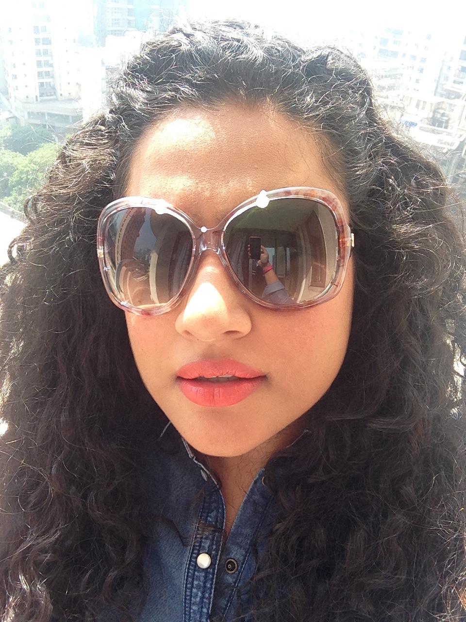 Sunglasses: Gucci