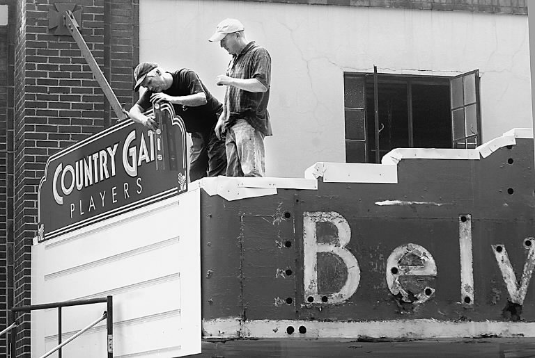 Alan Kull and Vic Kumma help install a new marquee in 2007.