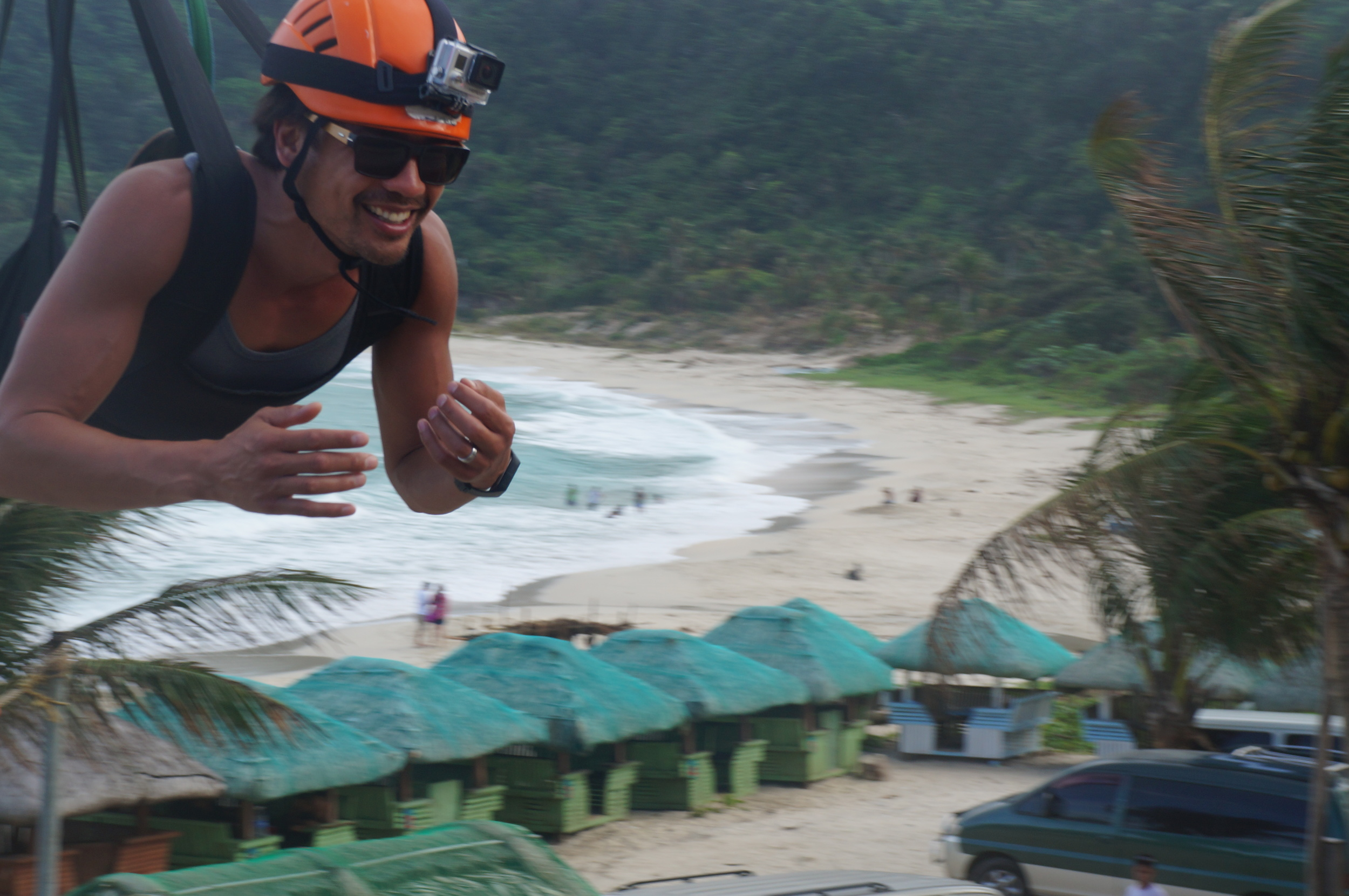 Jay flying down the longest zipline over the ocean in Pagudpud's Ilicos Norte.