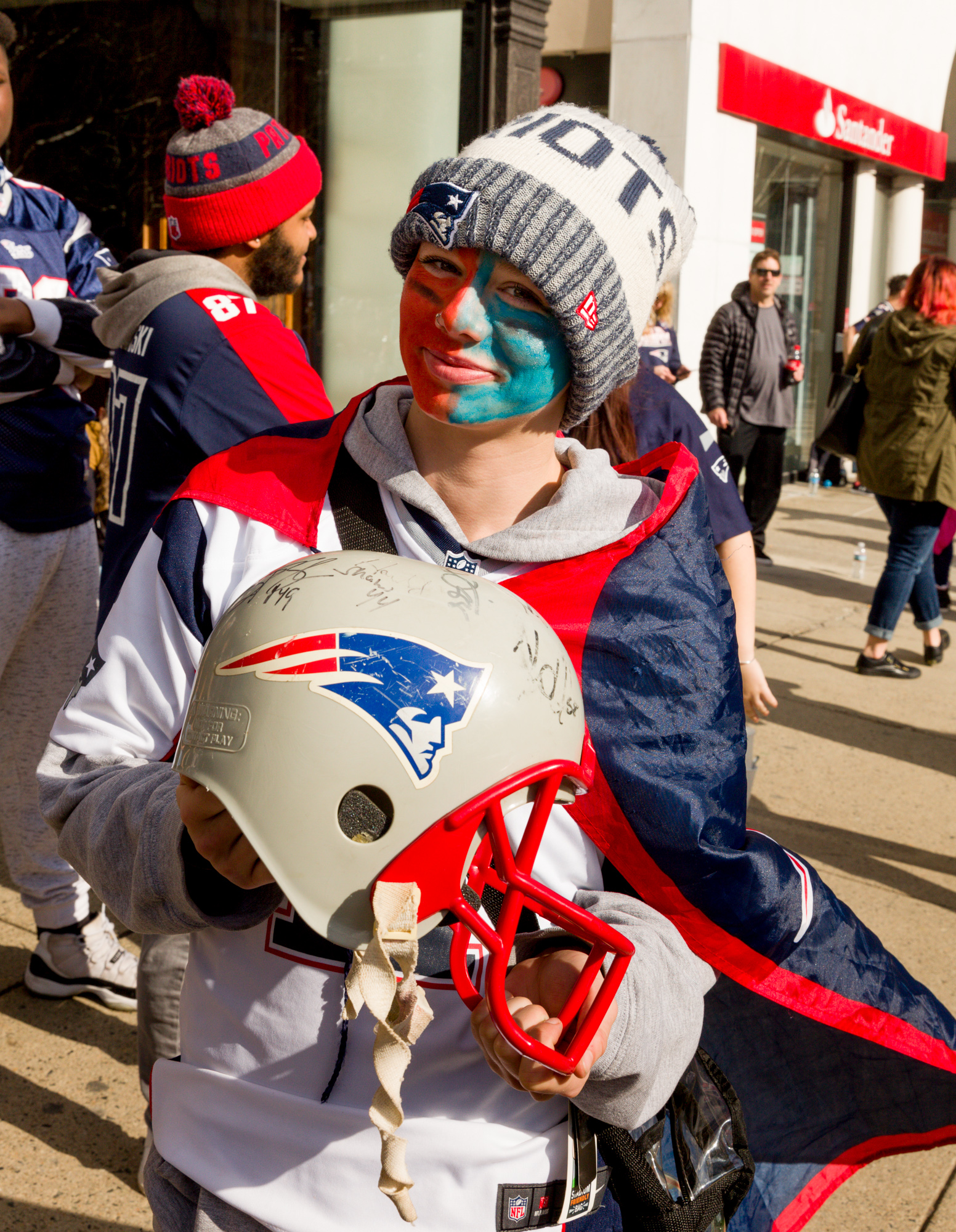 A girl and her plastic helmet with the authentic signatures.