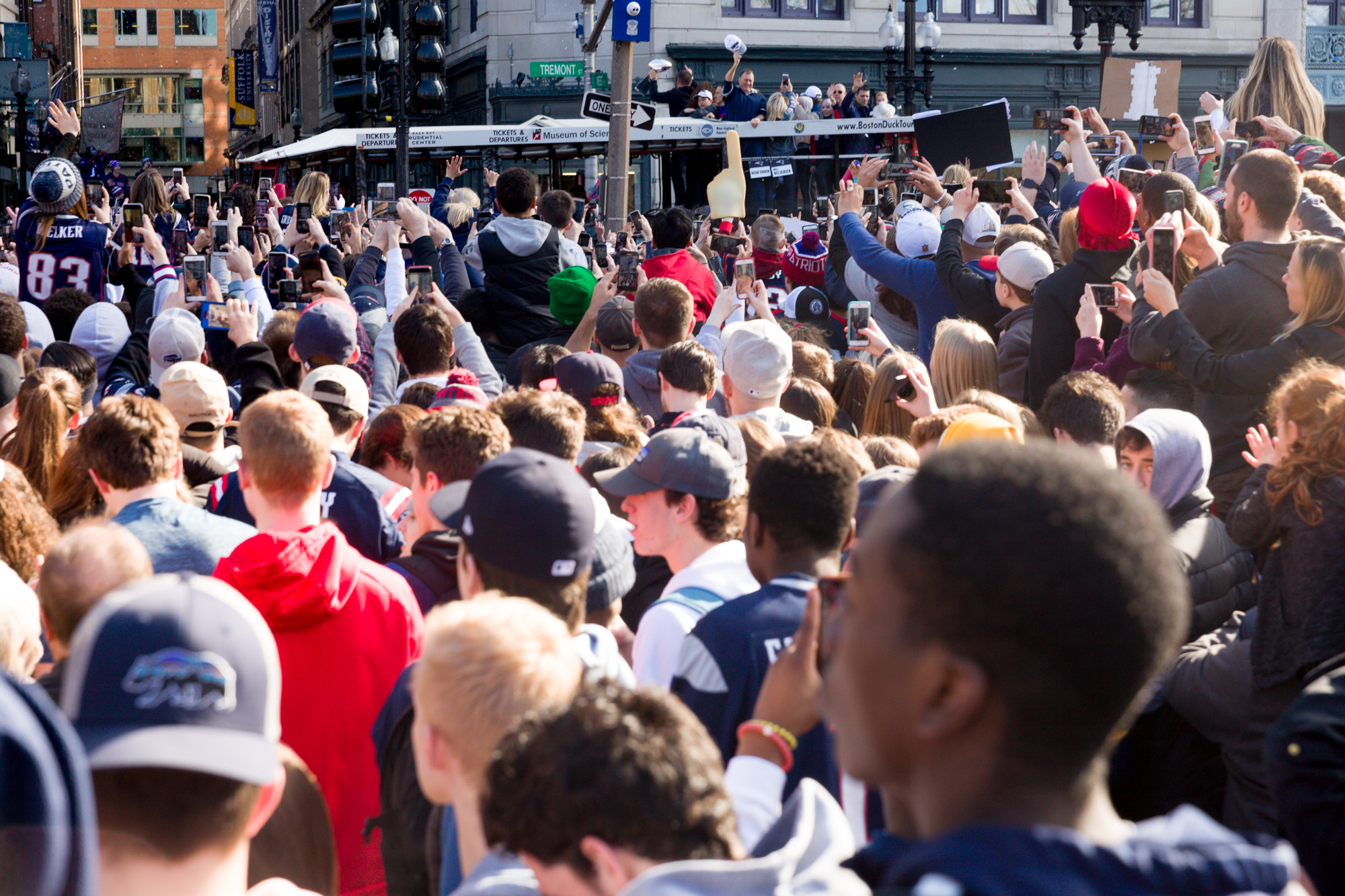 When we got back to Tremont St. from Boylston to see if we could get some more stuff, we were confronted with this huge mass of humanity which pretty much prevented us from getting much else. That's Bill Belichick again, way out there, waving his cap.