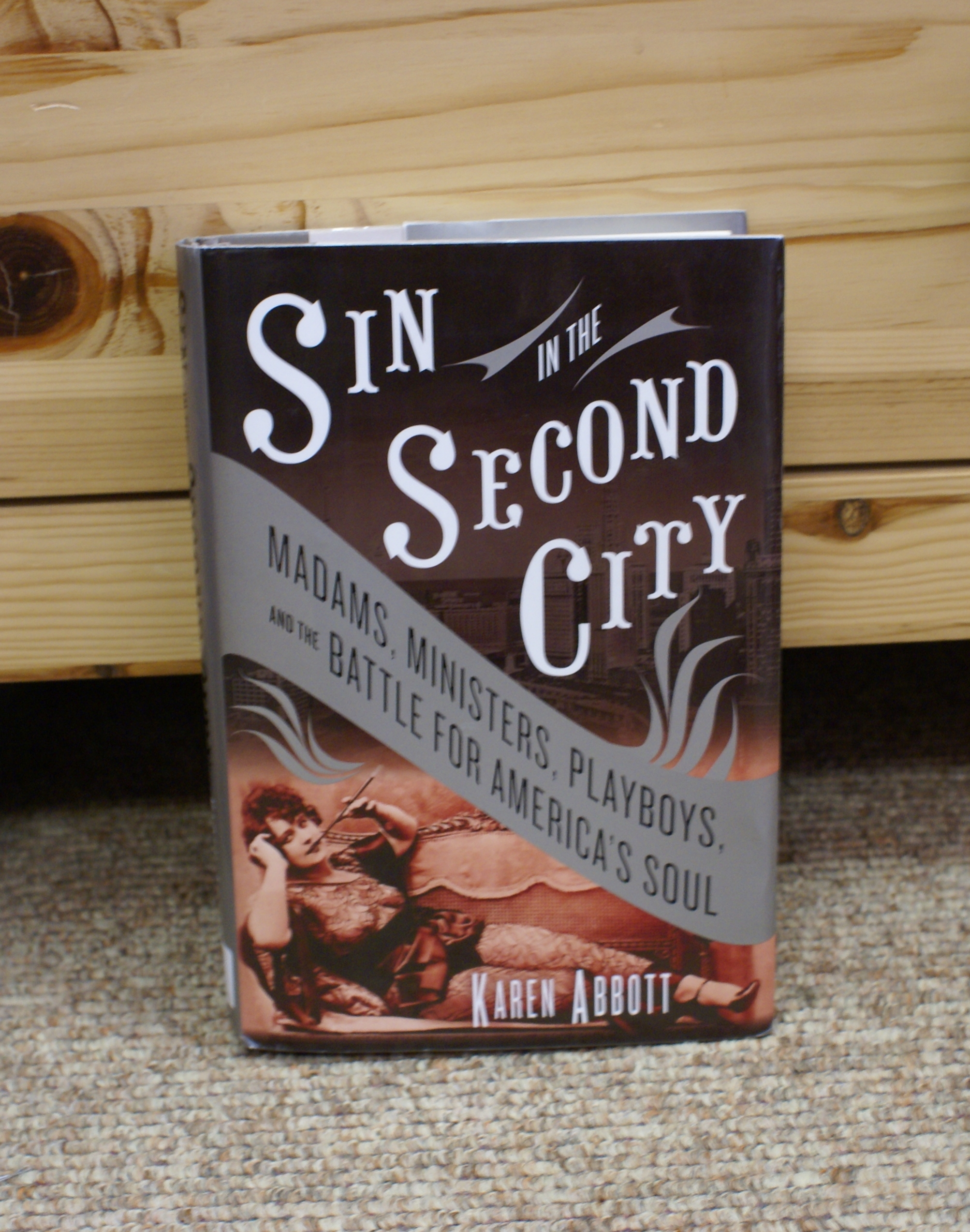 After a long cold winter, why not pick up a copy of  Sin in the Second City  and warm up? The History Center's choice of  Sin in the Second City  brings the book group back to Chicago with this sharp and popular history of morality, sexuality, and prostitution. Author Karen Abbott focuses on the Everleigh Club, a brothel on Dearborn Street.  Her success may stem from the general public's fascination with the seedy stories of history, and why not? Abbott's scope, though, includes an analysis of morality relative to time, gender, class, and locale. These elements make it much more than an exhibition of a sultry past. It is also a thoughtful consideration of the oldest profession in the context of twentieth century Chicago. The book will be discussed Wednesday, May 21, from 6-7 p.m. at the History Center.   And just so you know . . . Our book and Coffee Talk for July is Joe Kozenczak's  The Chicago Killer  about the John Wayne Gacy investigation. I had to set the book aside a couple times because Gacy's atrocity upset me. I chose this book because of the local connection and the fact that we could couple the book and Coffee Talk again. It is important to recognize and utilize firsthand information in doing history. Kozenczak was a valuable member of Des Plaines law enforcement for many years, and we are fortunate to be able to draw from his memories. —Philip Mohr