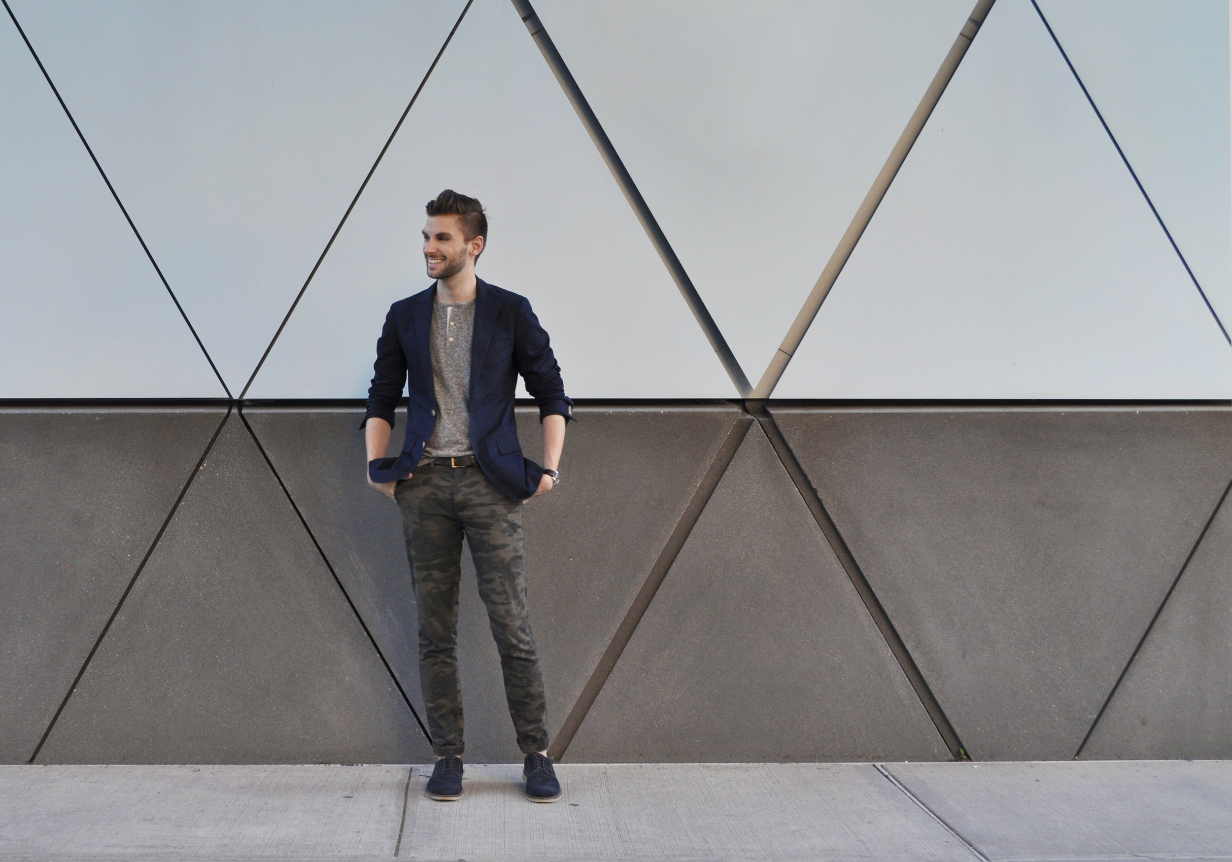 Matching camo chinos with a blazer strikes a perfect balance between high and low. It's a little rugged yet overtly street-smart. It equips you for every situation (meetings, brunch, cocktails, party etc.) and pairs well with so many different colors. It's been muggy the last few days so I kept it cool with a lightweight marled henley and pushed up my sleeves for a bit of attitude.  Try lacing your oxfords straight across for a sharper look. It's particularly nice with wingtips. There's already so much business going on at the toe, it cleans up the whole look a bit more. Keeping with the streamlined look, i threw on my timeless  Burberry  watch. It's classic and goes with everything!  How are you wearing the camo trend these days?   Club Monaco blazer  and  henley  / Banana Republic camo chinos ( similar ) and  oxfords  /  Burberry watch