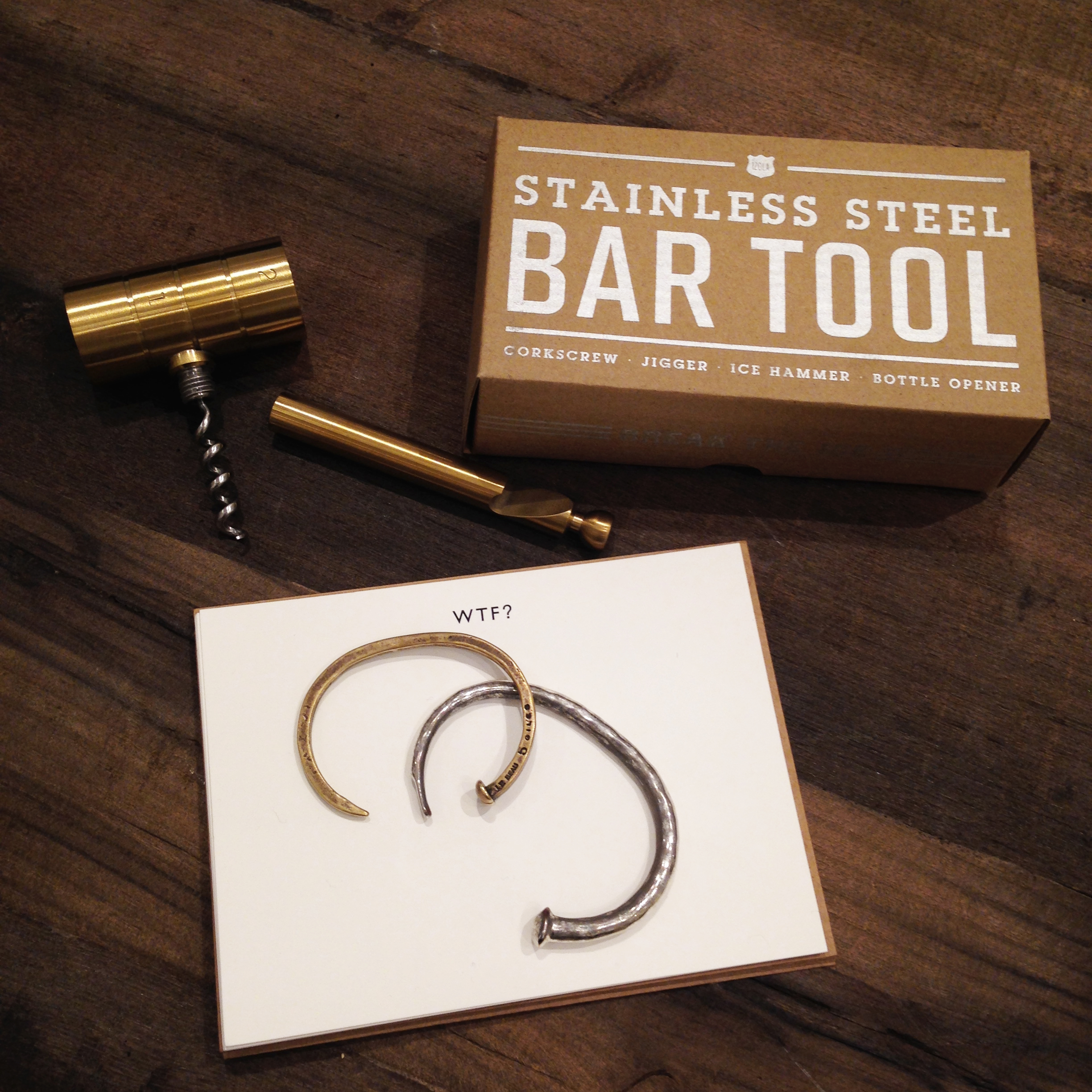 """1.   Izola 4-in-1 Bar Tool  - This is an awesome gift for any guy. You can measure liquor, open a bottle of wine, open a bottle of beer and break ice all with one tool. Comes in brass or silver and this streamlined box. Izola is an NYC based company and most of their products are Made in America. It's run by two guys who are passionate about bringing beautiful design to everyday objects.I picked this one up for someone I know and now I just want to keep it for myself! #sorrynotsorry  2.   Terrapin Stationary   - Terrapin is another family run NYC brand and they have some kick-ass stationary. I know you're thinking """"who uses stationary anymore?"""". Well, you will when you see their cards. What better way is there to say """"I love you"""" than """"Je F*cking T'aime""""? (Which they also have printed in English if you're not that classy). It's like Don Drapper on a thank you note. They're sold online and in a few different retailers. Check out their site for a full list.  3.   Giles & Brother Railroad Spike Cuff   - I love Giles & Brother. I wear this cuff almost every day and for those guys who have yet to venture into jewelry, it's a great introduction. Simple, clean, masculine, and goes with everything. I'm upgrading to the safety pin cuff next!  4.  Banana Republic Nail Cuff  - I have a thing for cuffs. What can I say? I keep picking up silver ones to wear with my watches. It adds that little bit of subtle style all guys need. This one isn't available online, but most BR stores are carrying it right now."""