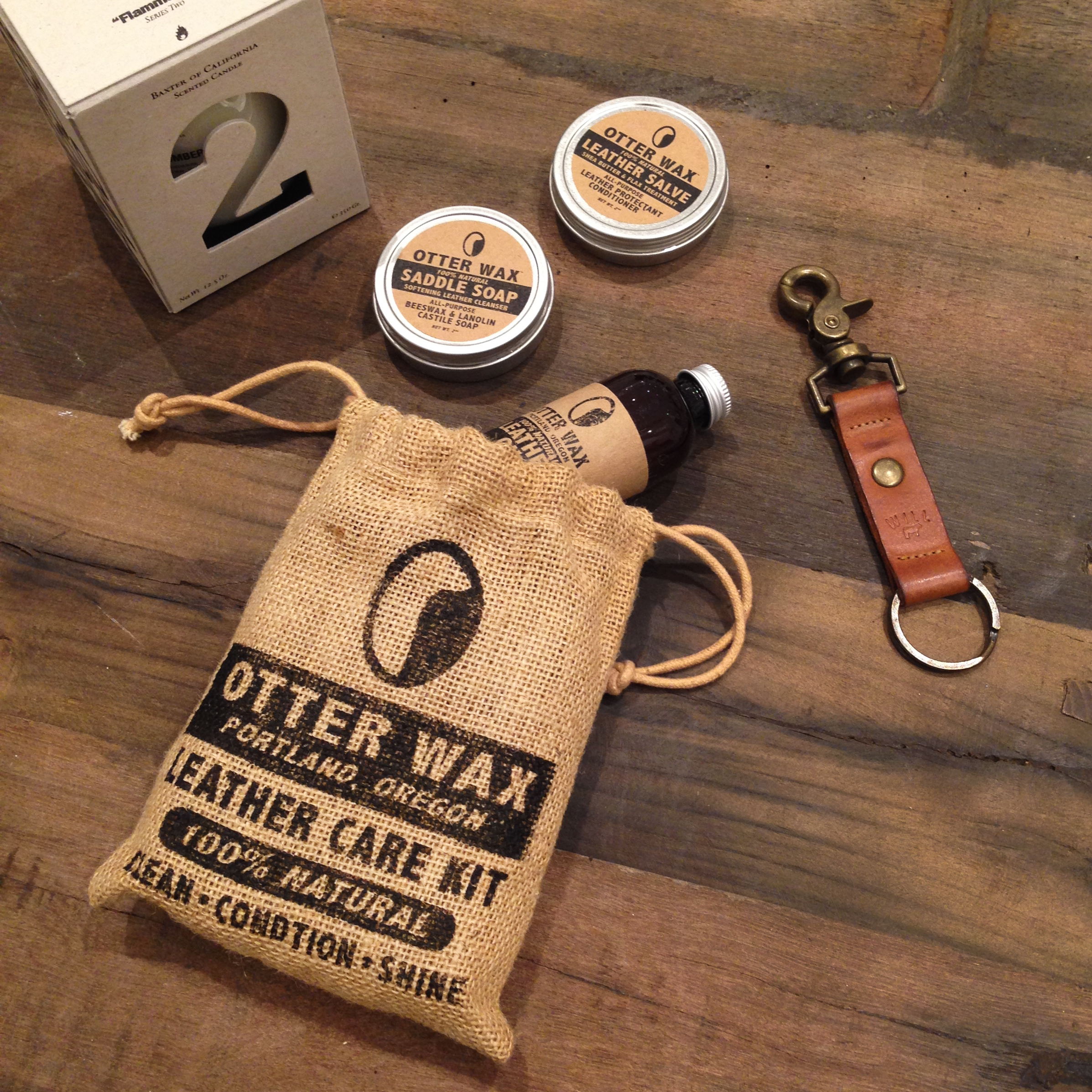 5.   Otter Wax Leather Care Kit   - I'm an Otter. I couldn't resist including a little Otter Wax in my stocking. This Portland company has some greatproducts to protect and maintain your leather through the Winter. It's perfect for guys who are really hard on their boots (like me).If you're investing a couple hundred on a pair meant to last a thousand miles, you need to look after them. Also sold in stores all over--so check out their site for more dets.  6.   Will Leather Goods Key Fob   - We'll call this the West Coast part of the post. Will Leather Goods is based in Cali and all of their leather goods areMade in America. They make awesome bags, but you can never go wrong with a sturdy key ring. Everything is made to last and will better over time. It's a no-brainer.  7.   Baxter of CaliforniaCandle   - Yes, they make candles for men. And they're bro-tastic (yeah, I went there).Baxter is a men's personal care company whomakes some of the best smelling candles out there. They have two series: Wood and Ash. The Wood have clean scents that aren't floral like most candles. My favorite is Number 1, but all 3 are regulars in my apartment. The Ash Series smell exactly how they sound. Smoke Ash is like a camp fire in your apartment. It's a great gift for any man cave.