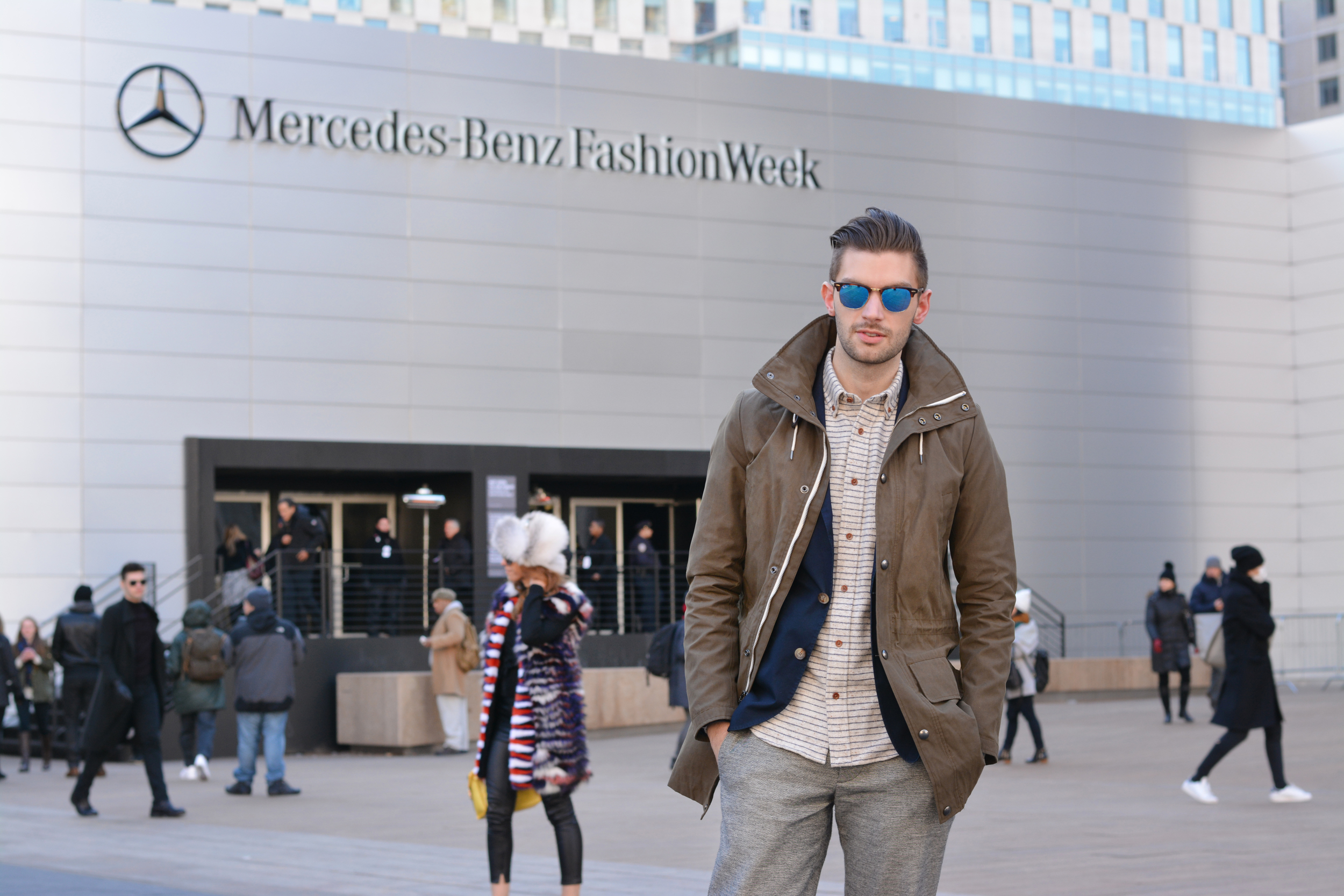 This season's biggest trend is  hypothermia .  Fashion influencers and bloggers alike are migrating to Lincoln Center to collectively pretend we are warm in 10 degree weather!The only relief is the runway!  Ikid. I kid.I'm sure that woman in the fur hat and striped jacket behind me is warm...  But really... Loving my new Club Monaco parka and super glad I had a thick shirt and blazer underneath. Feeling Spring 15' colors while livingAW15' weather.  Some of my favoritesfrom the runway so far?Todd Snyder's tailored wool trench coats, the patternedjackets from Concept Korea, and the neoprene bombers from Ricardo Seco. I'm all about that outerwear! Maybe that's just where my mind is at... Oh, and the varsity cargo joggers from Mark McNairy (who, p.s., previewed his collection like a film premiere. I watched Nick Wooster take'selfies' of Nick Wooster walking in arunway show on a movie screen. Very meta.)  More to come as the week unfolds. Temps set to drop to 0* on Monday so we may be previewing collections from our living rooms...  Club Monaco Parka,  blazer , shirt ( similar ) and  trousers  /  Stan Smith Adidas sneakers  /  Rayban sunglasses