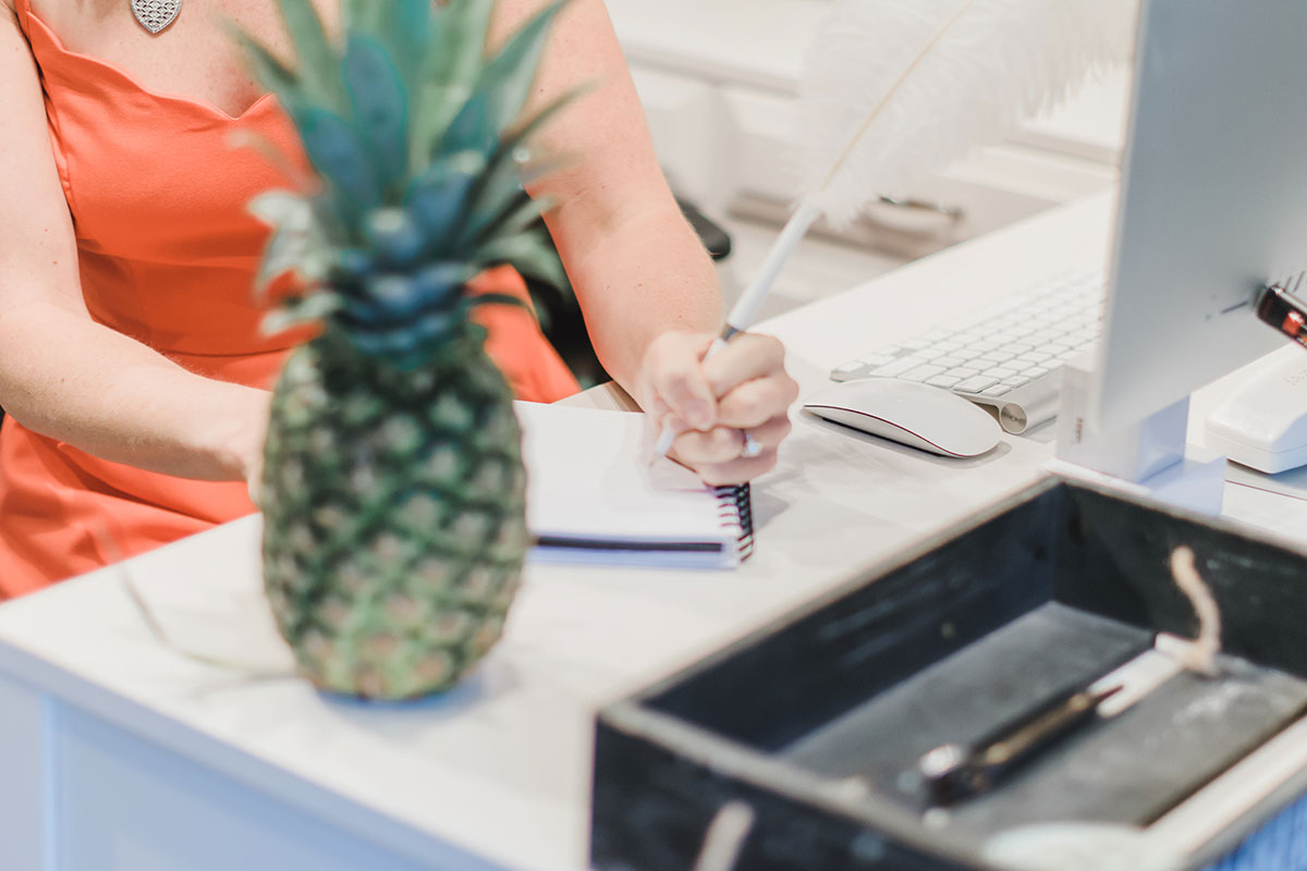 Writing-With-Pineapple-On-White-Desk.jpg